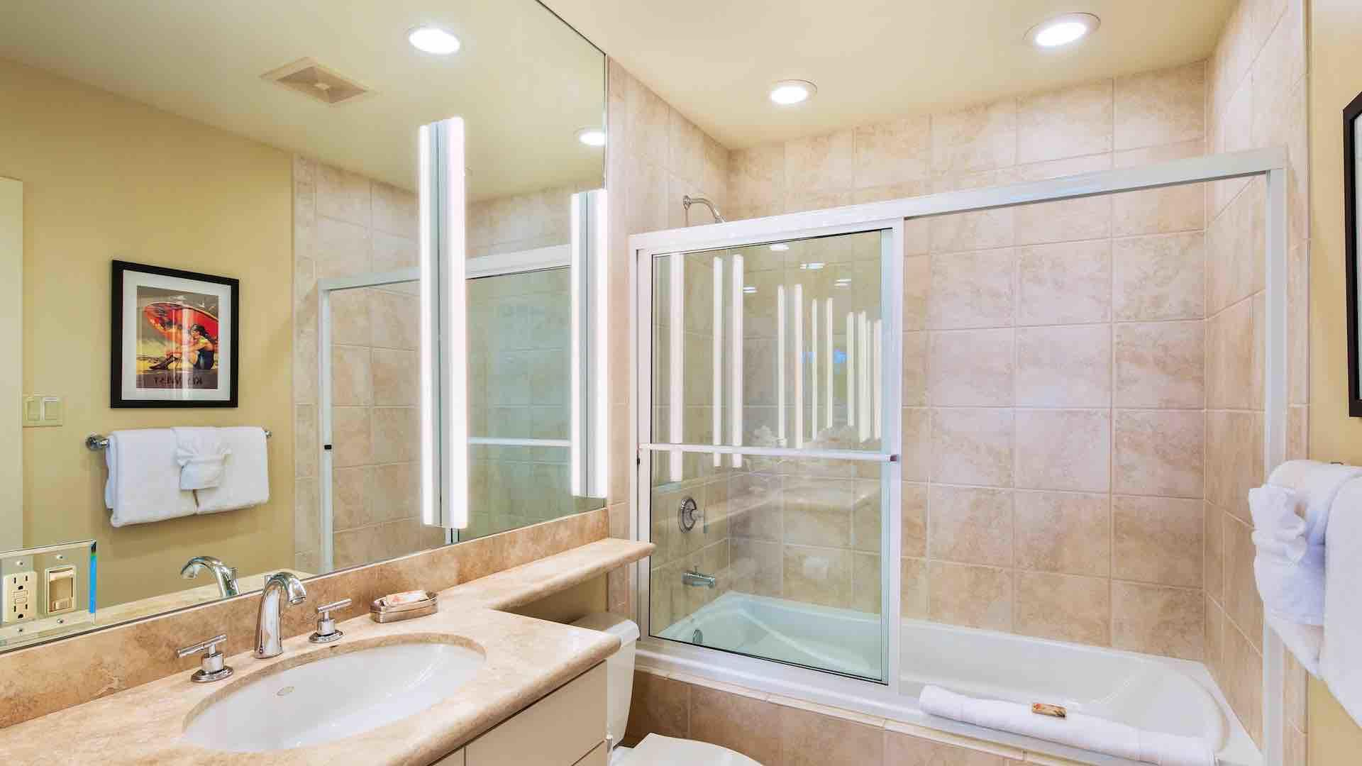 The second bedroom has an en suite bathroom with a glass enclosed tub & shower…