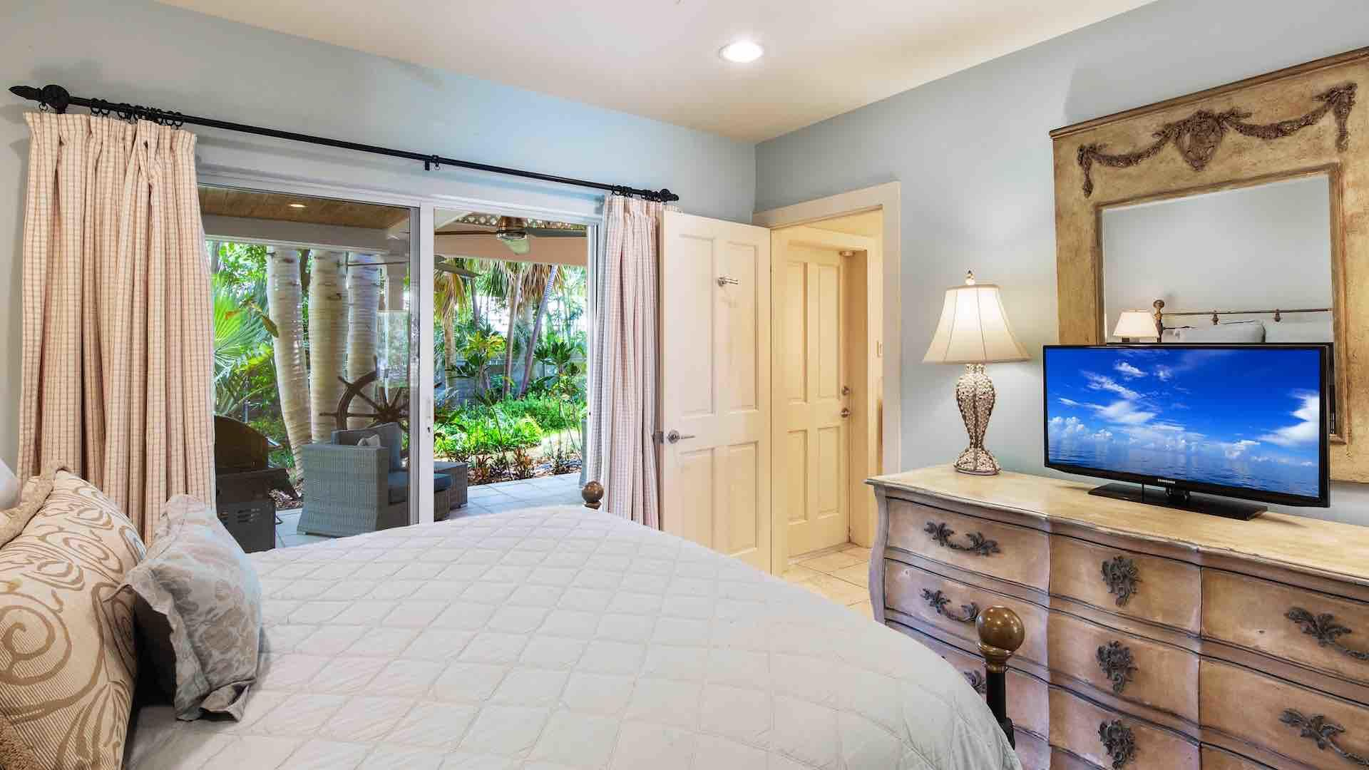 The second bedroom features Queen bed, ceiling fan & a flat screen TV...