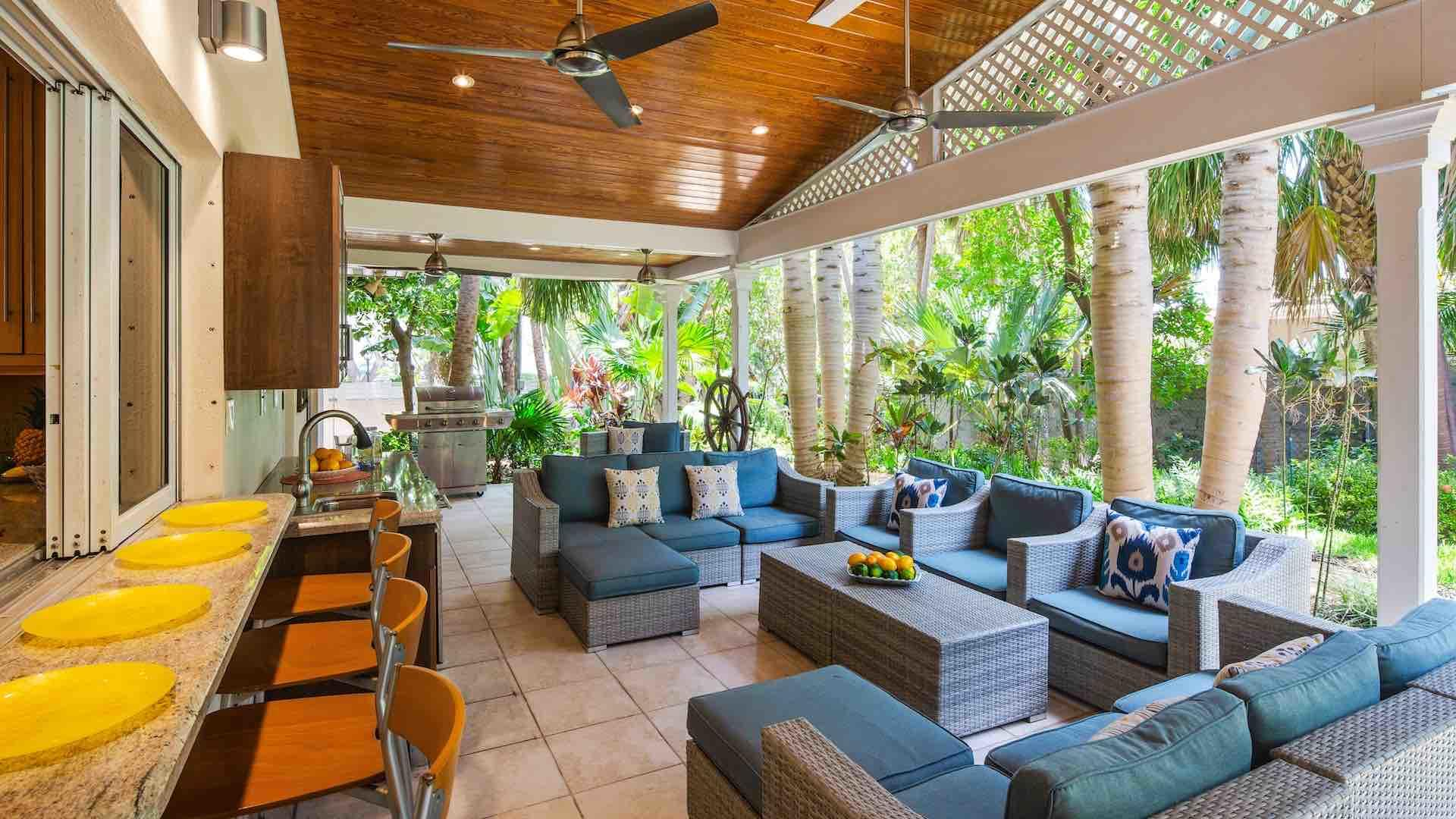The covered back porch is the perfect place to enjoy the island breezes...