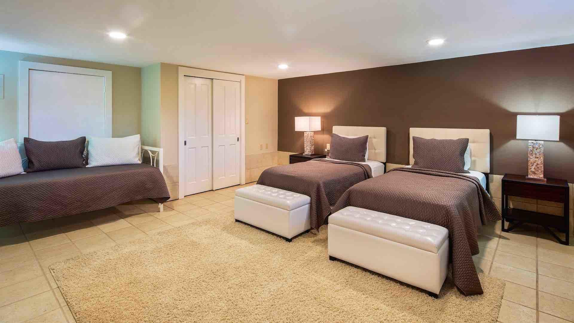 The fourth bedroom has a large closet and extra seating...