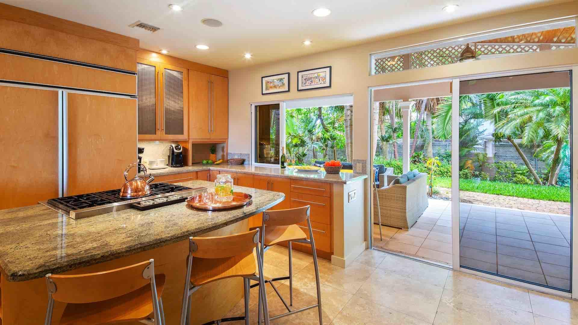 The kitchen features all top of the line appliances & passthrough to the porch…