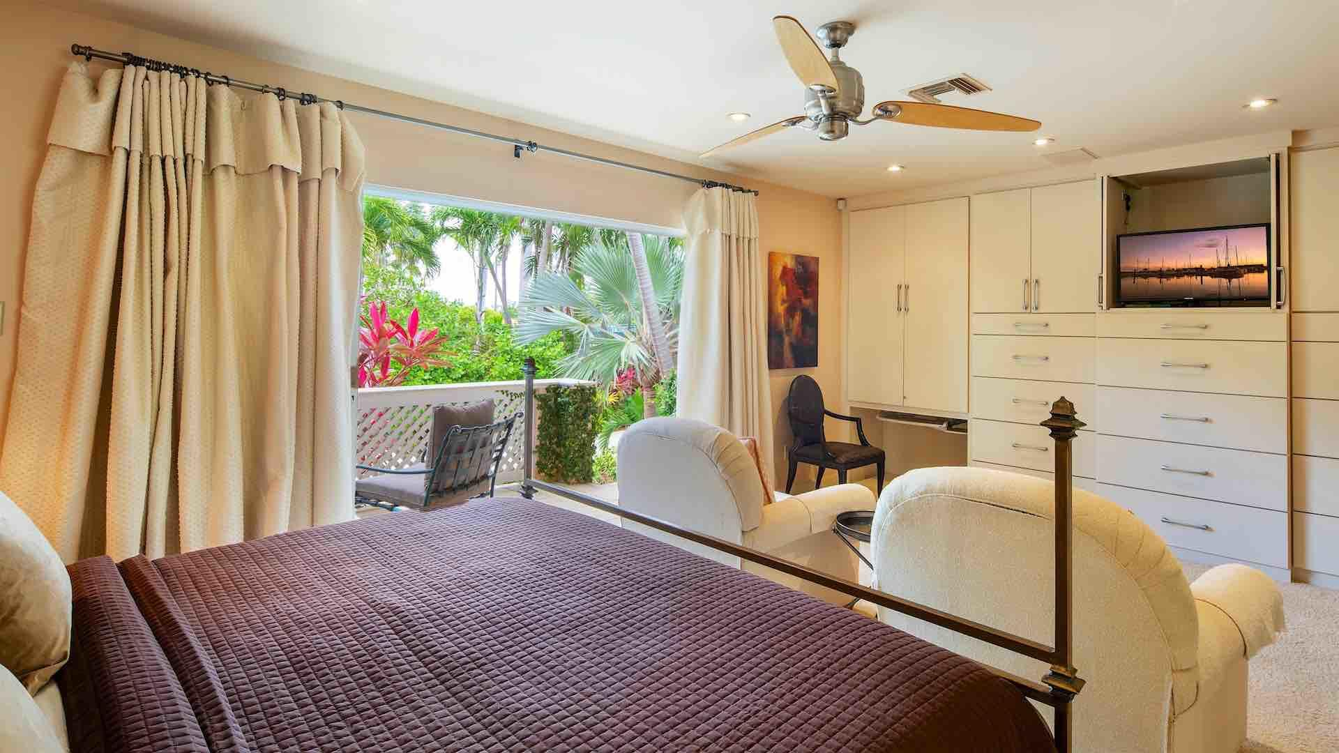 The first master bedroom suite has a King bed and sliding doors to a balcony…