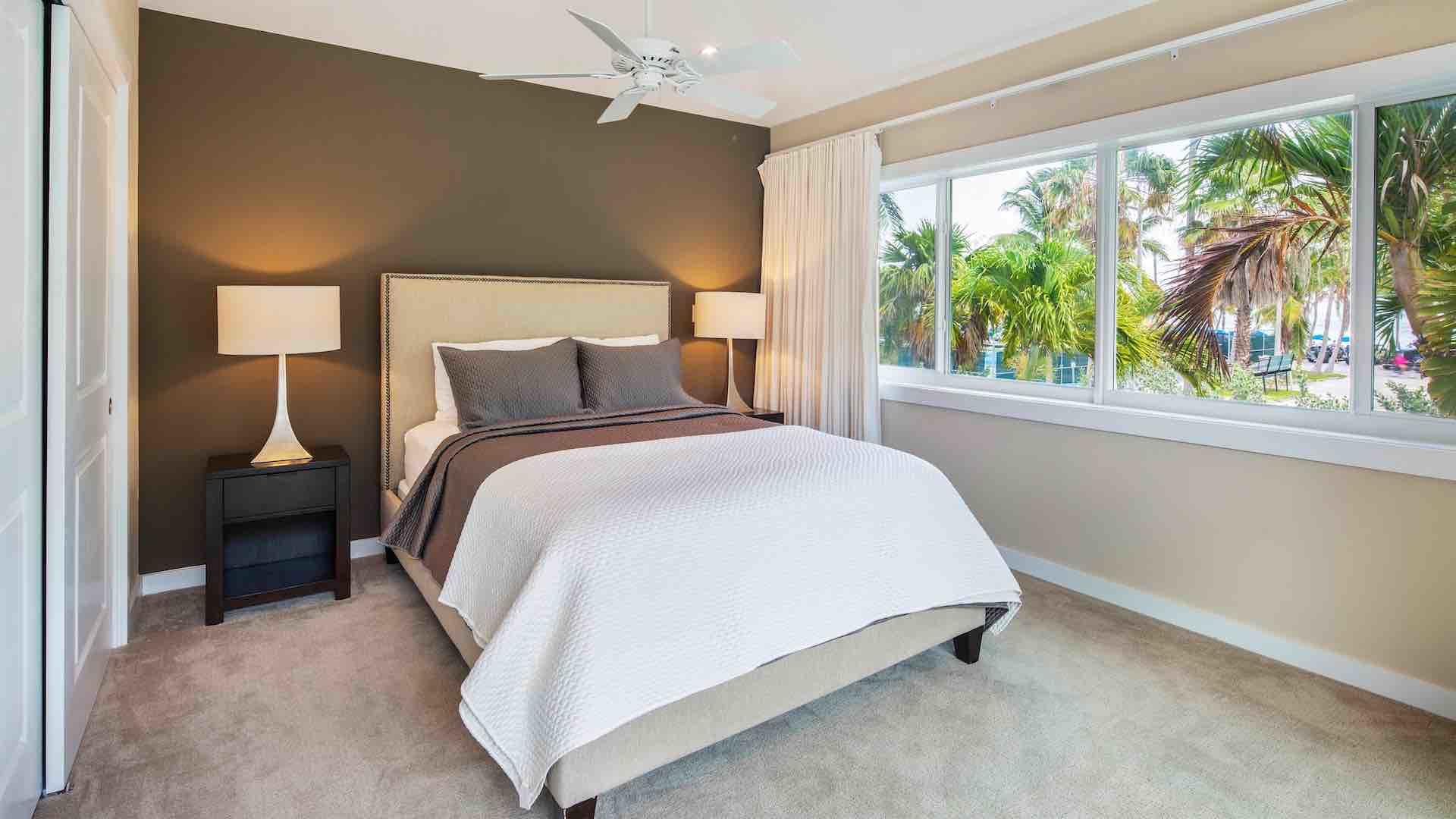 The second master bedroom suite is very private, with King bed and overhead fan…