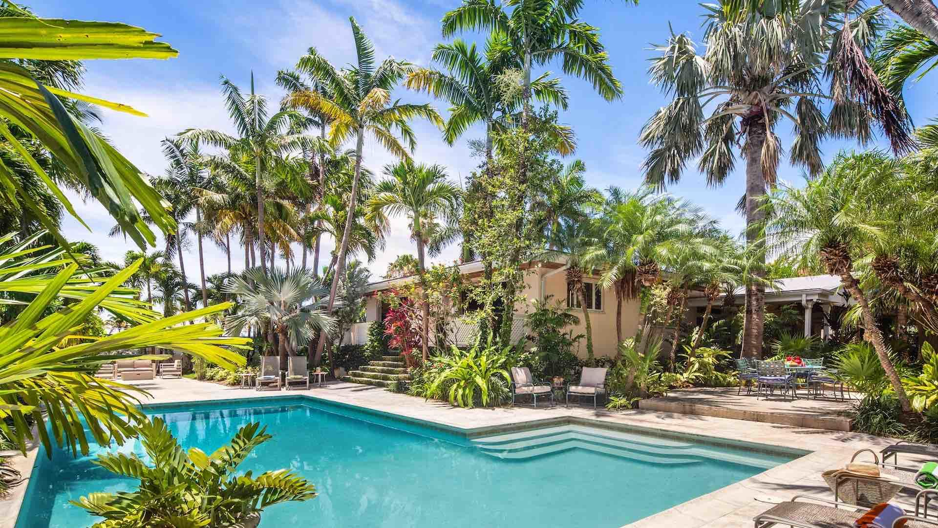 Large patio and pool area in this 5 bedroom Key West vacation home steps to the beach