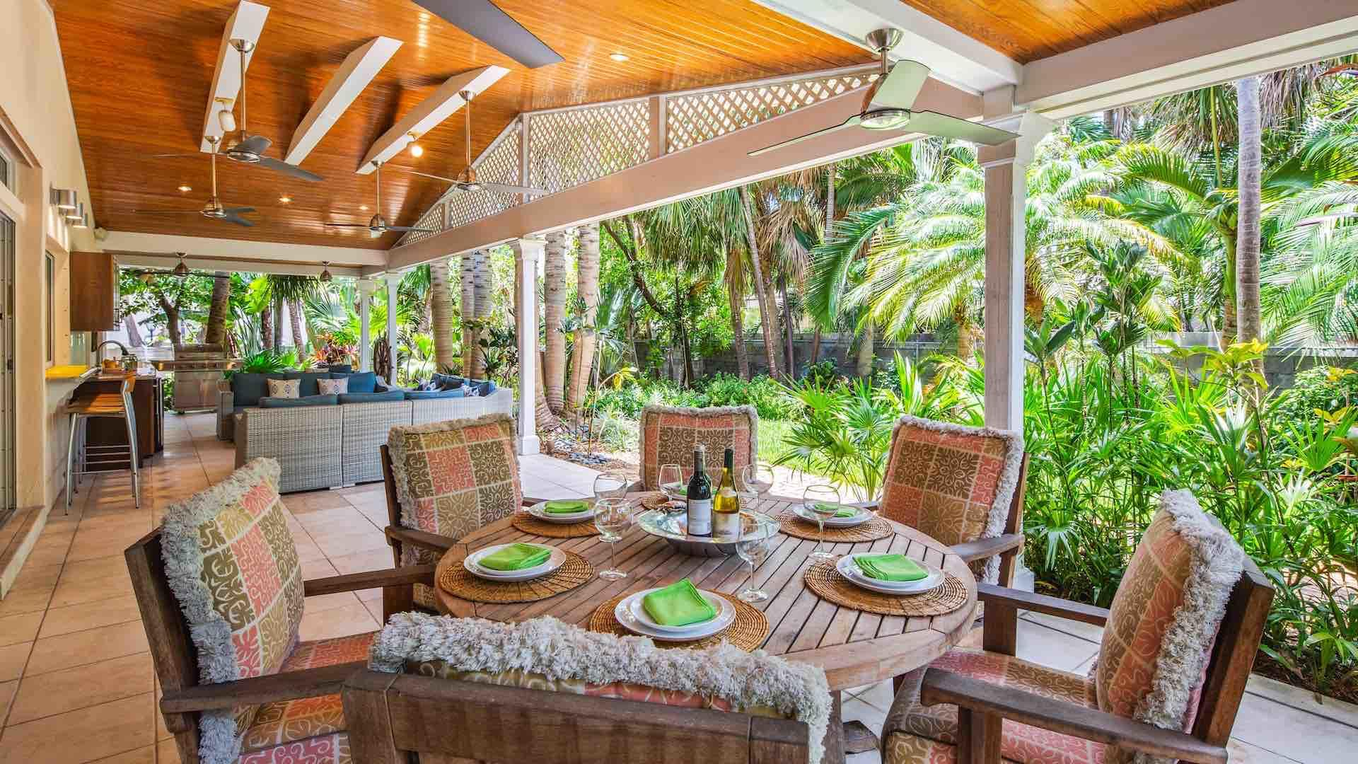 The back porch also has a covered outdoor dining table that seats up to six...