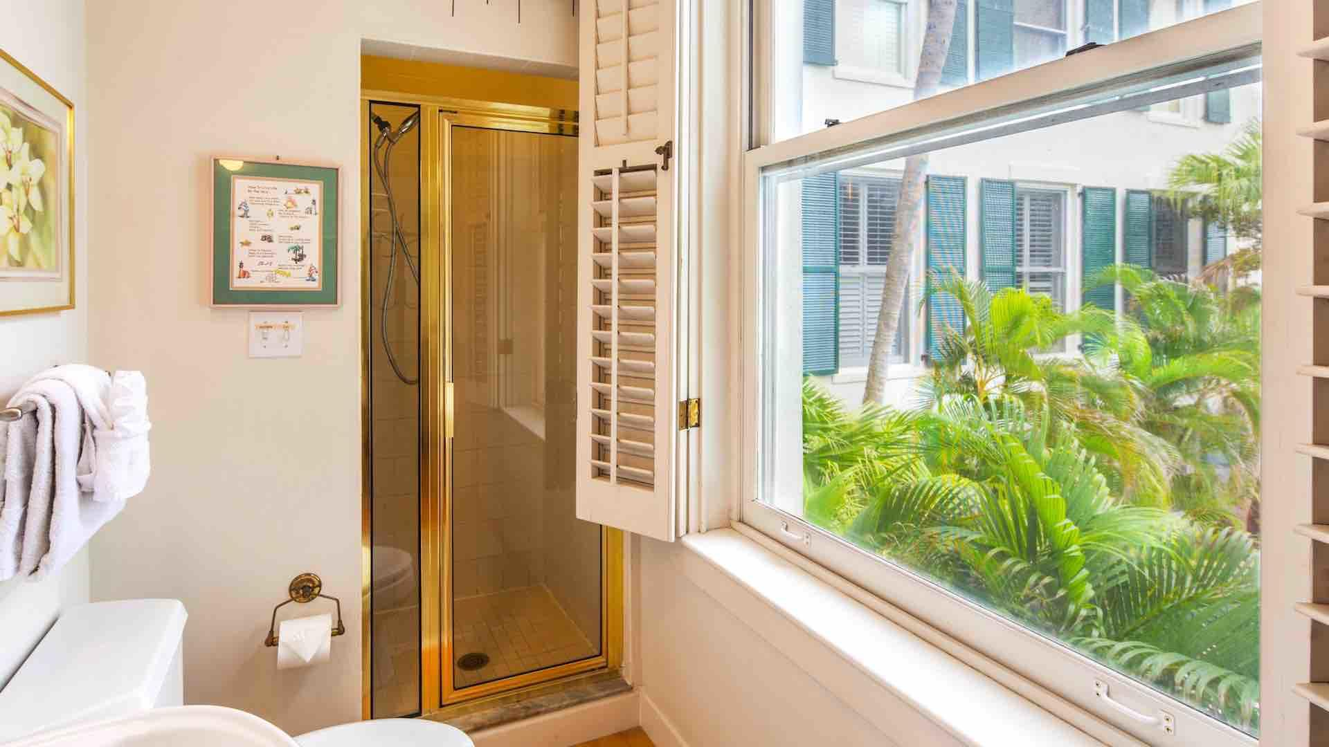 The second bathroom is located in the hall and has a walk-in shower...