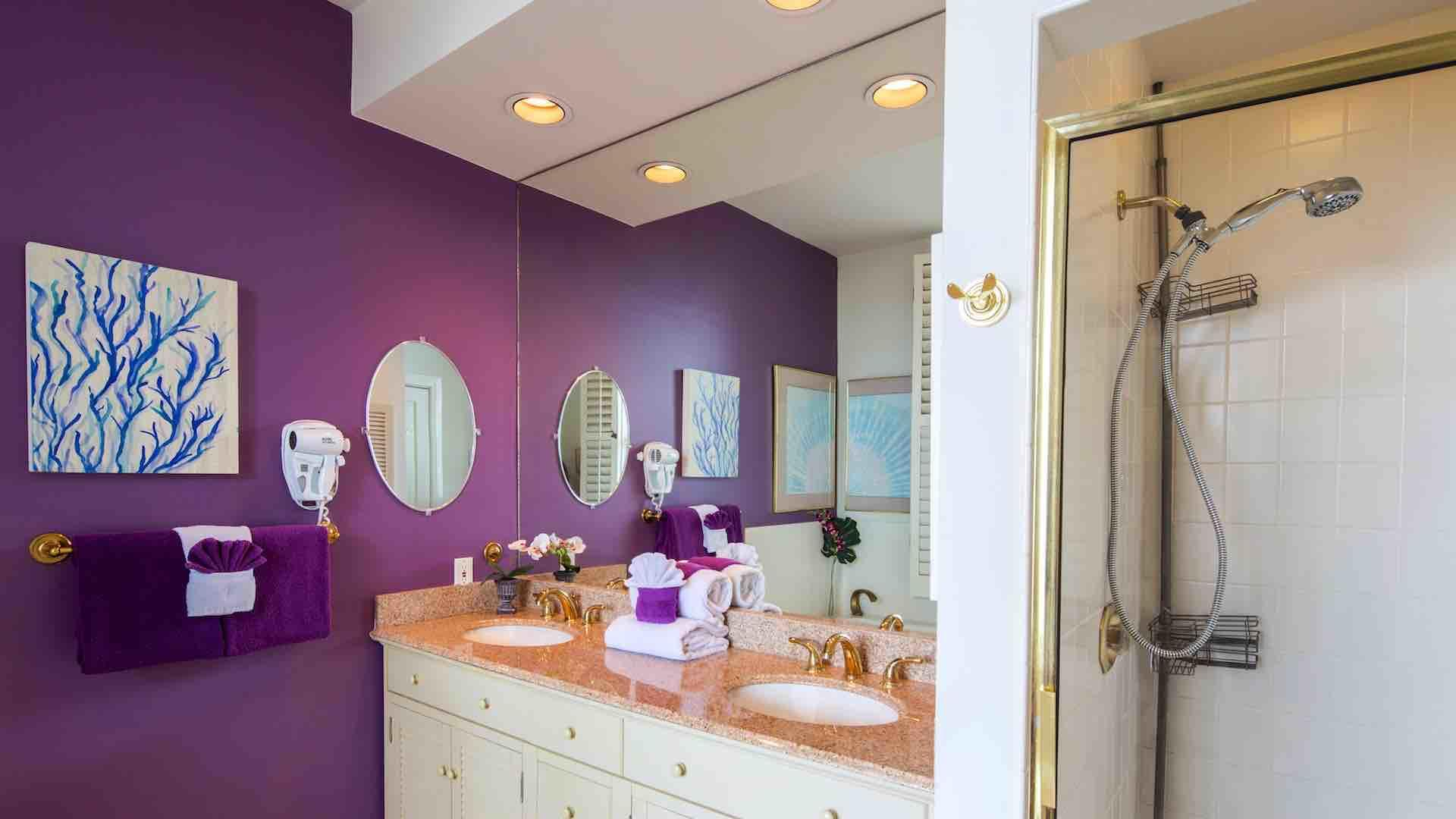 The master bathroom has twin vanities and a walk-in shower...