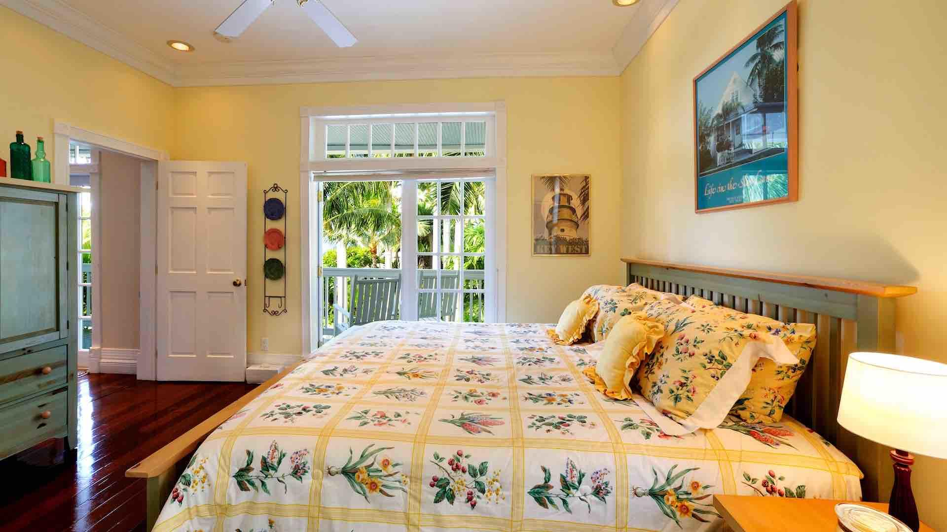 The fourth master suite is on the first floor, with a King bed and French doors...