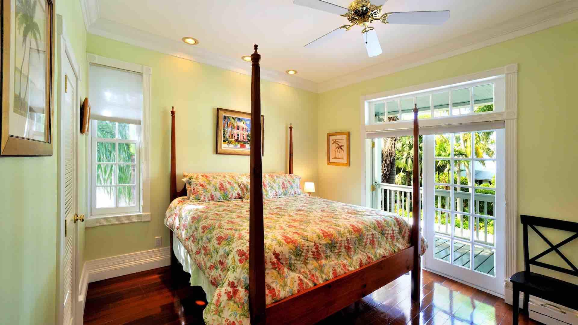 The fifth master suite has a King bed and French doors to the front porch...