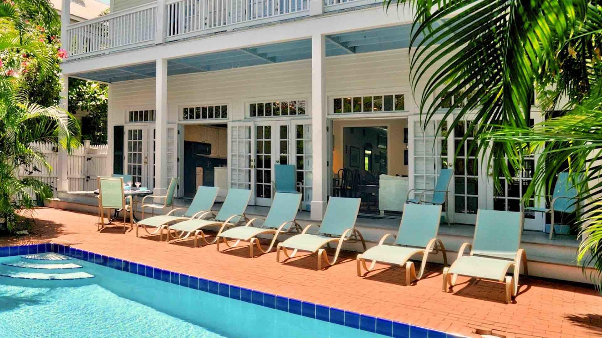 The pool deck has plenty of seating for everyone, with plenty of privacy...
