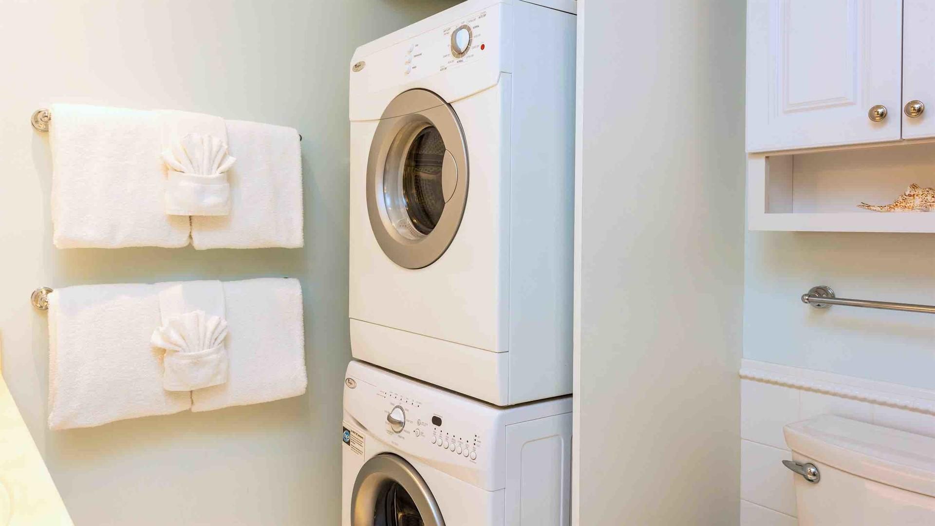 The washer and dryer are also located in the bathroom...