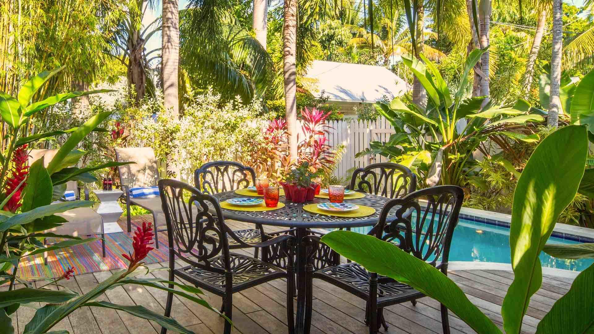 The backyards are each complete with a large propane grill and dining set for an outdoor barbecue by the pool...