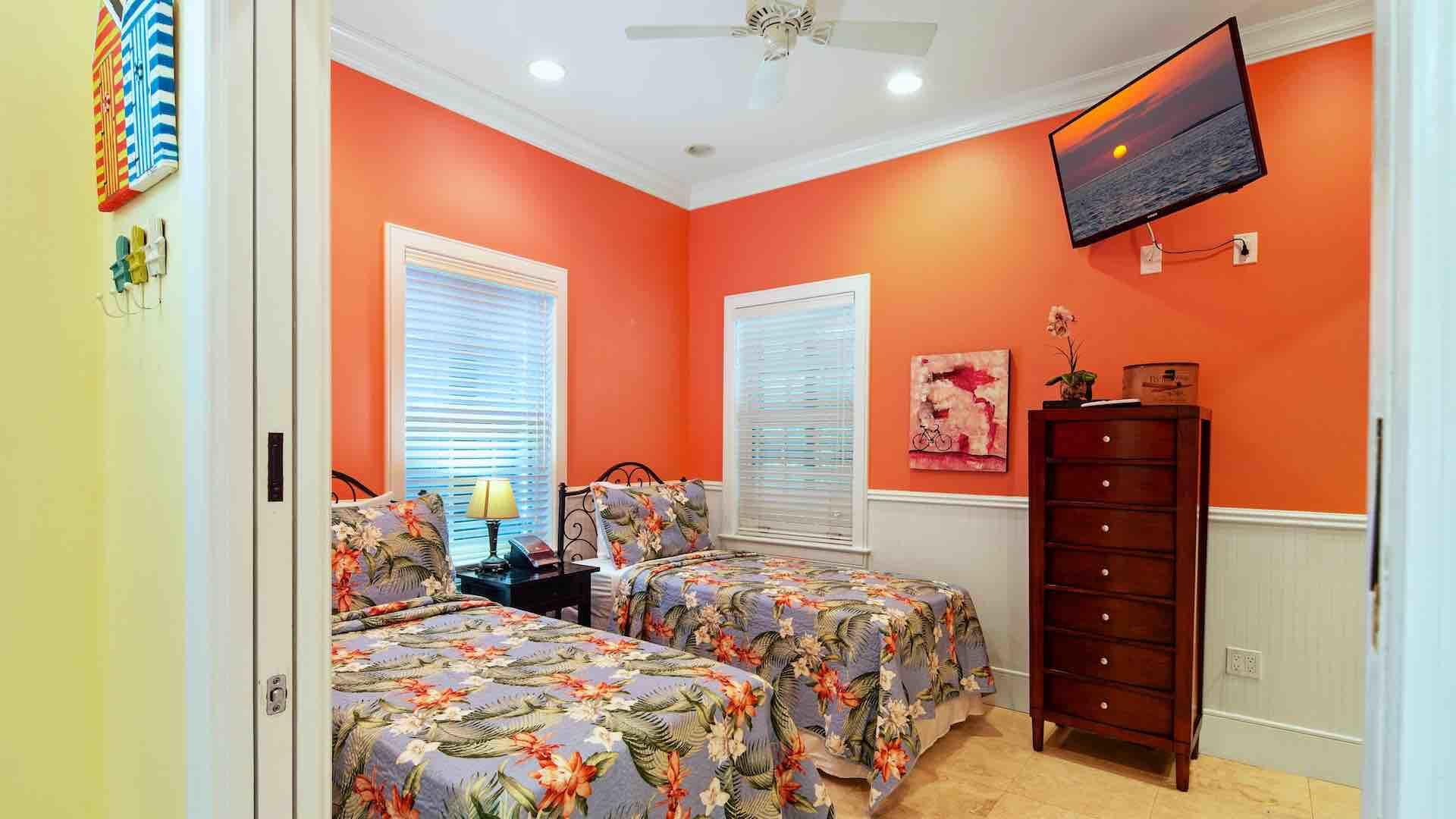 The first bedroom also has an overhead fan and a flat screen TV...