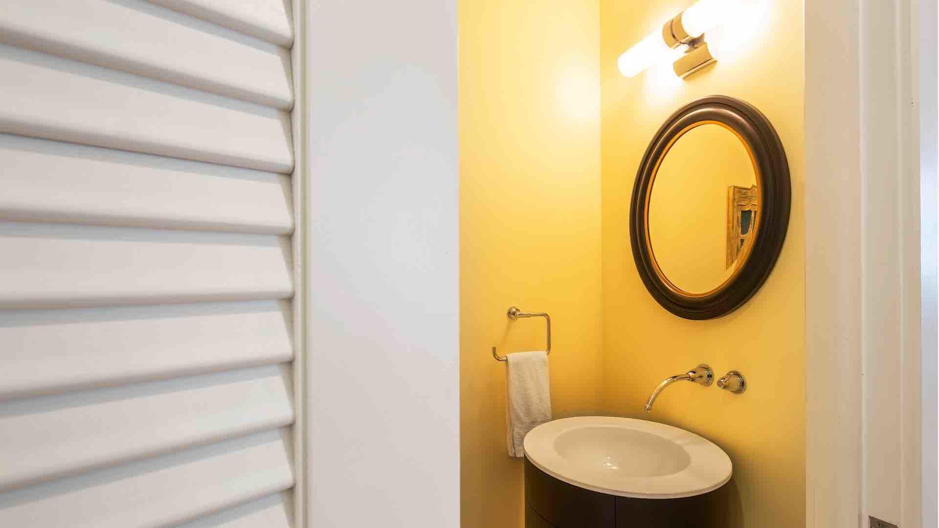 There's a convenient half bathroom located just off each living room/kitchen area...