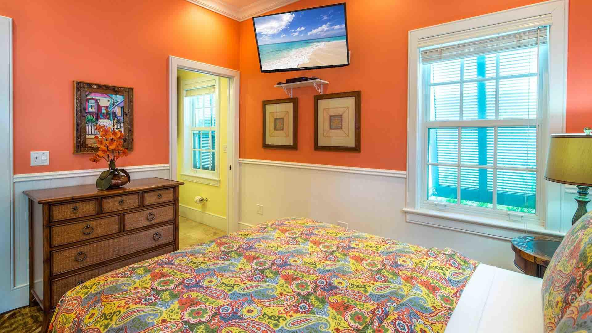 The fourth bedroom has a Queen bed and a flat screen TV...