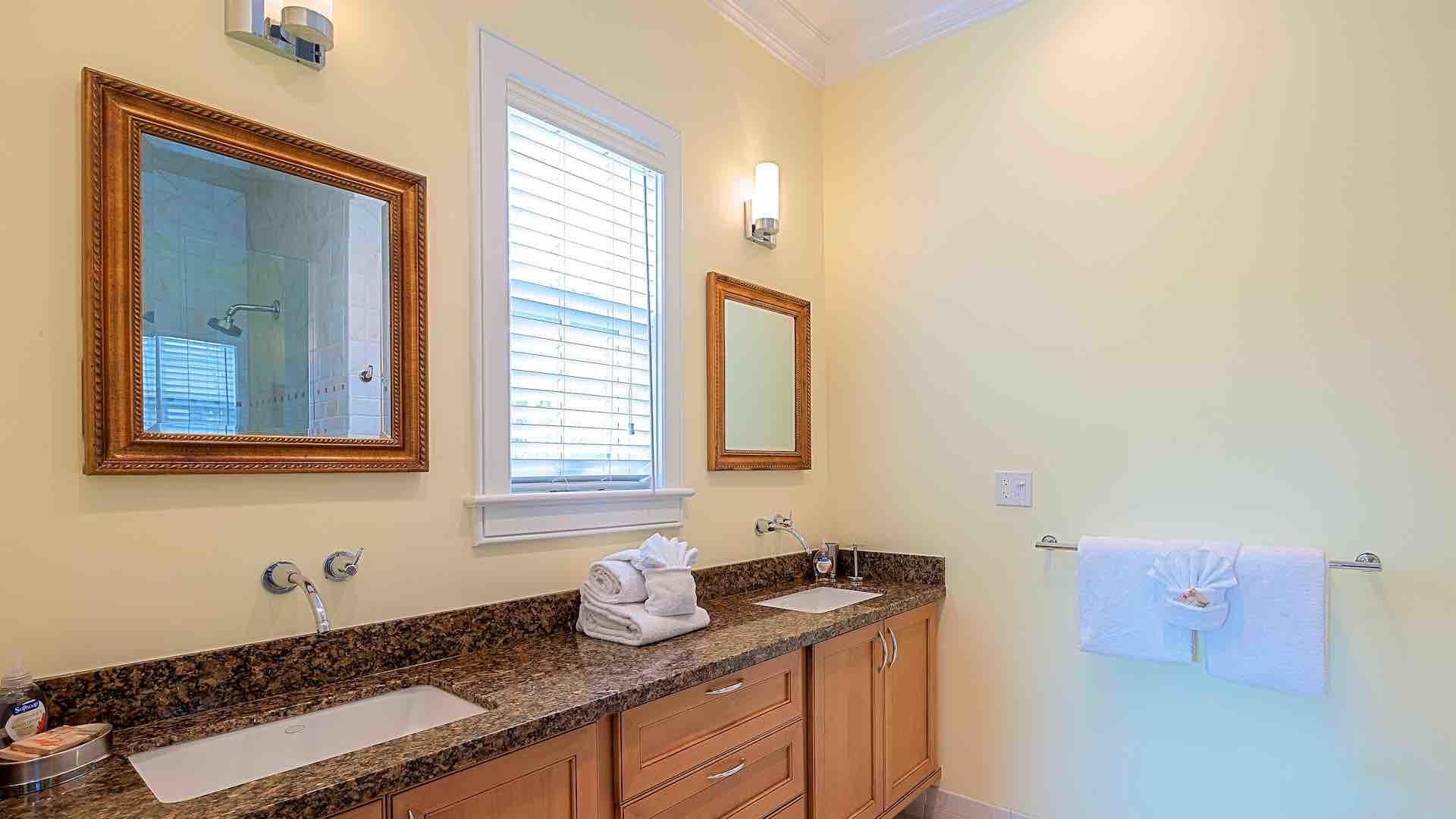 The second master bathroom has a large double vanity...