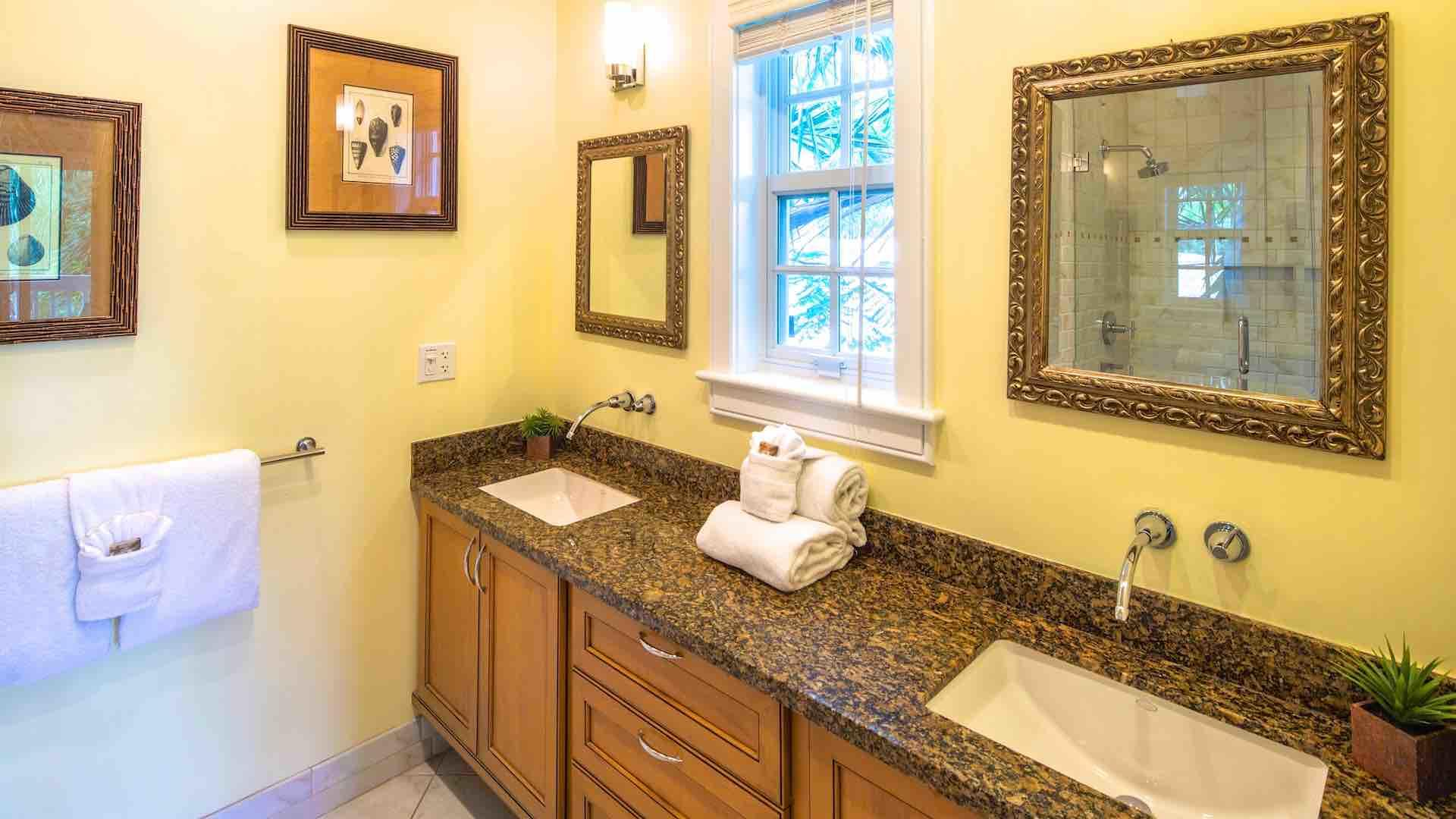 The first master bathroom has a his and her vanity...