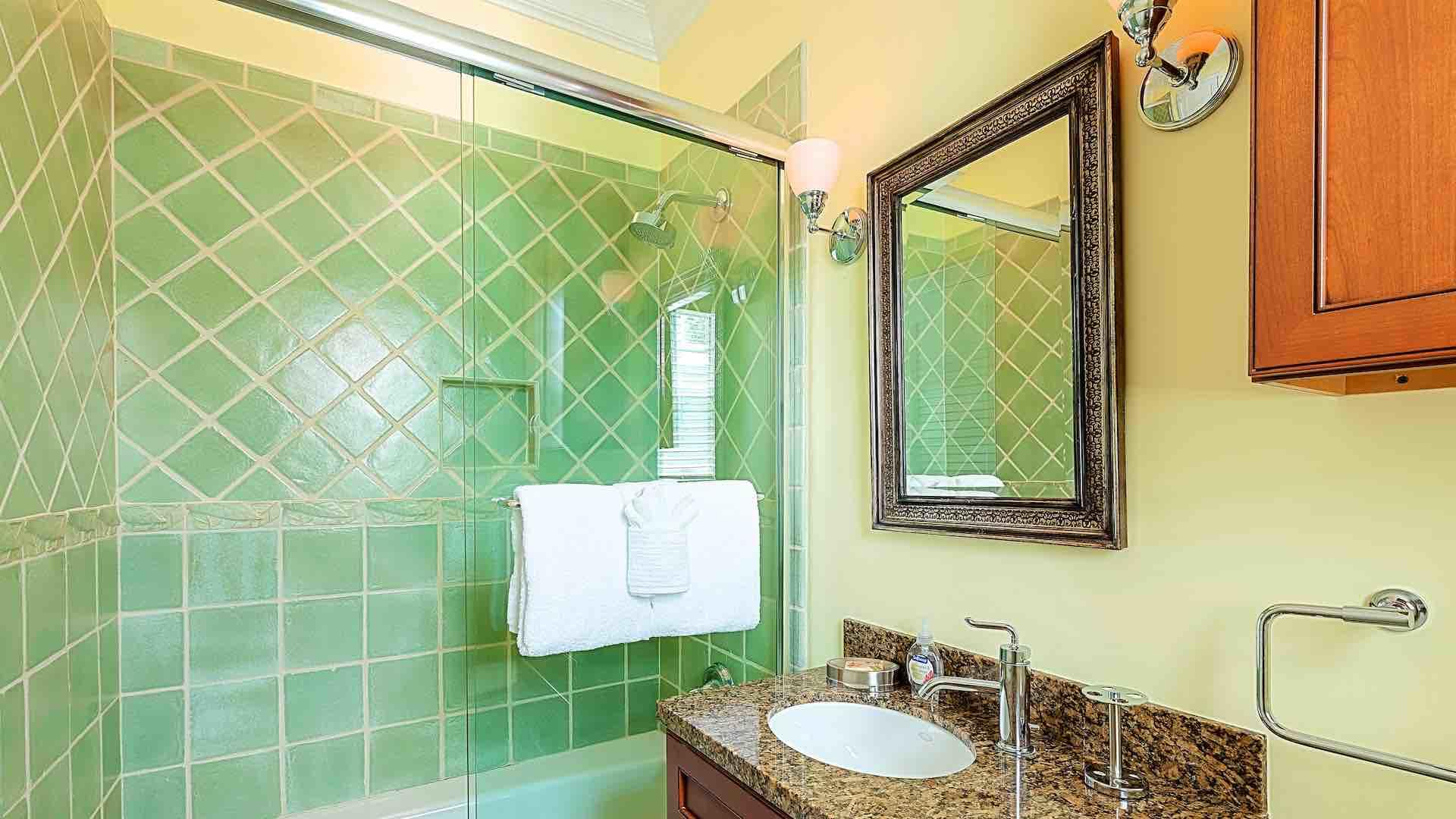The sixth en suite bathroom has a glass shower and tub combo...