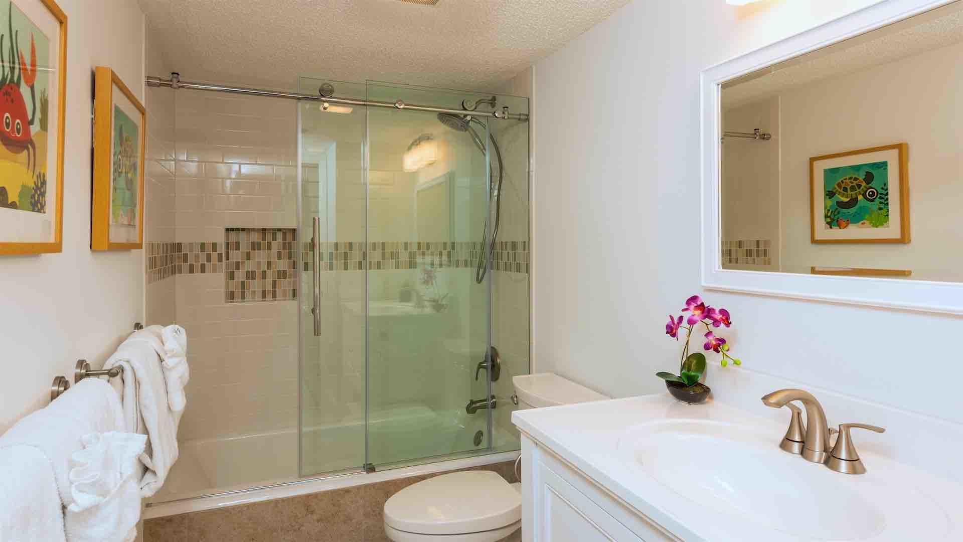 The second bathroom is across the hall and has a beautiful large custom shower..