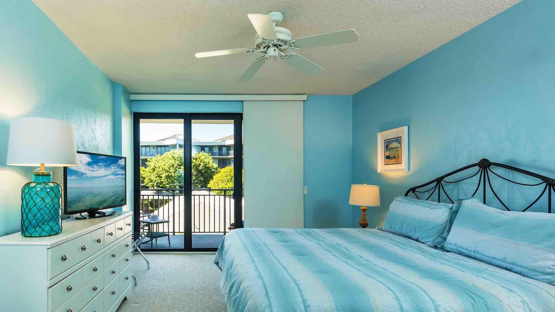 The master bedroom has a king bed and access to the large balcony...