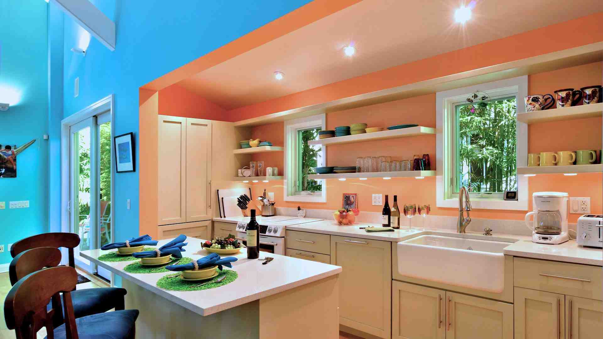 The custom kitchen is fully equipped with top of the line appliances...