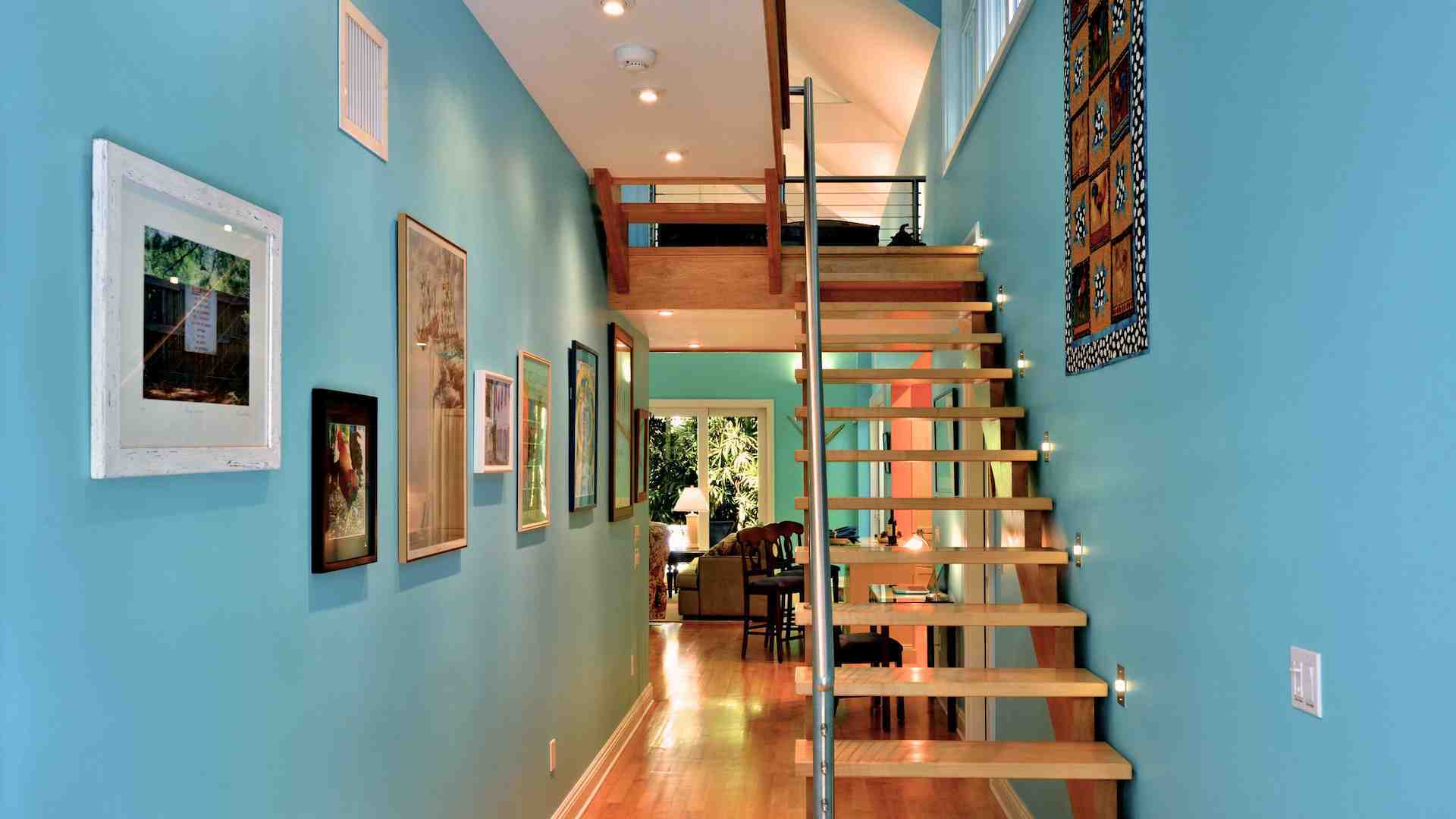 The one of a kind staircase provides access to the 2nd floor, with two bedrooms...