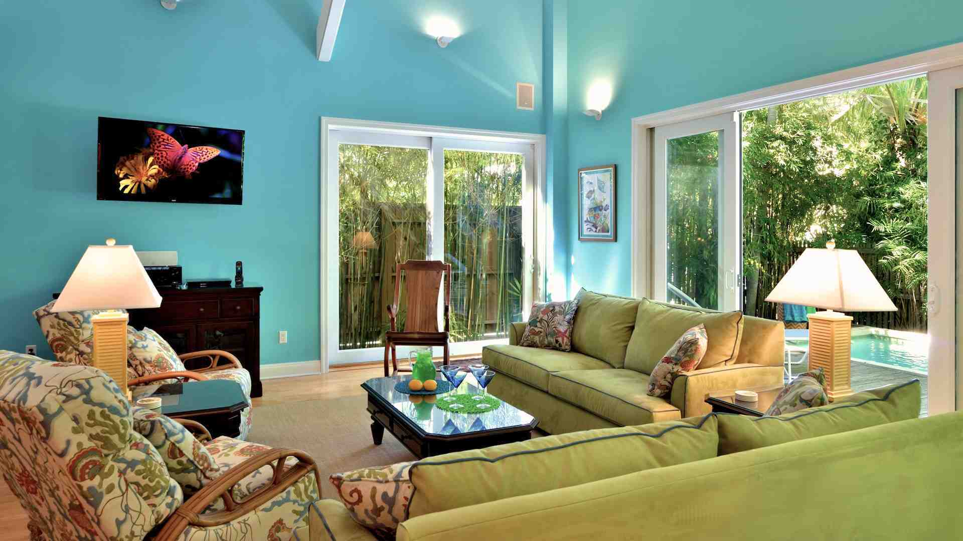 The living area has a large flat screen TV and comfortable seating options...