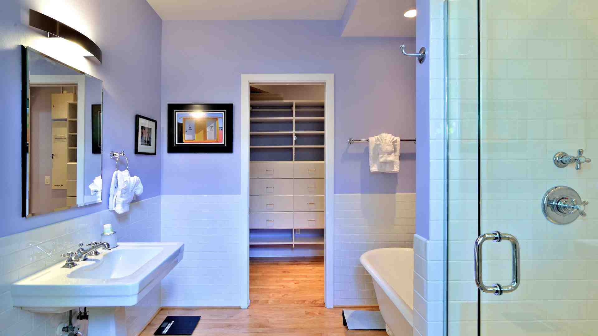 The master bathroom is en suite with clawfoot tub & large frameless glass shower...