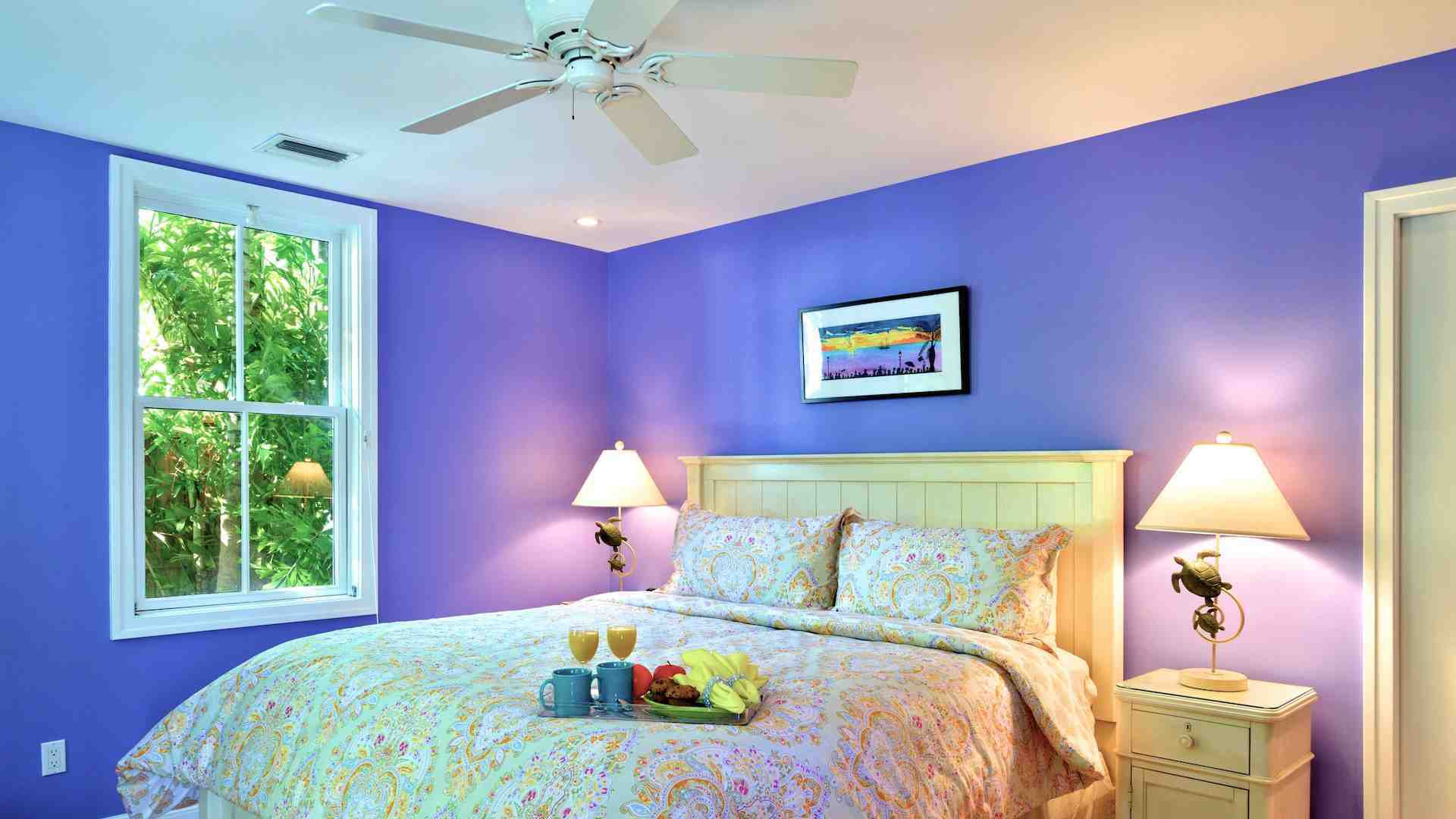 The master bedroom is on the first floor, with a king bed and overhead fan...