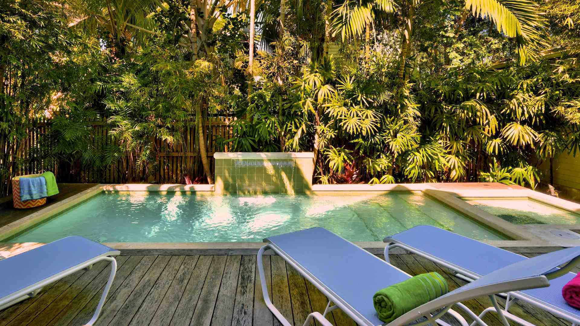 The pool features a soothing waterfall and a separate Jacuzzi large enough for four...