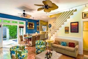 The living room is spacious; the French doors keep the house light and breezy...