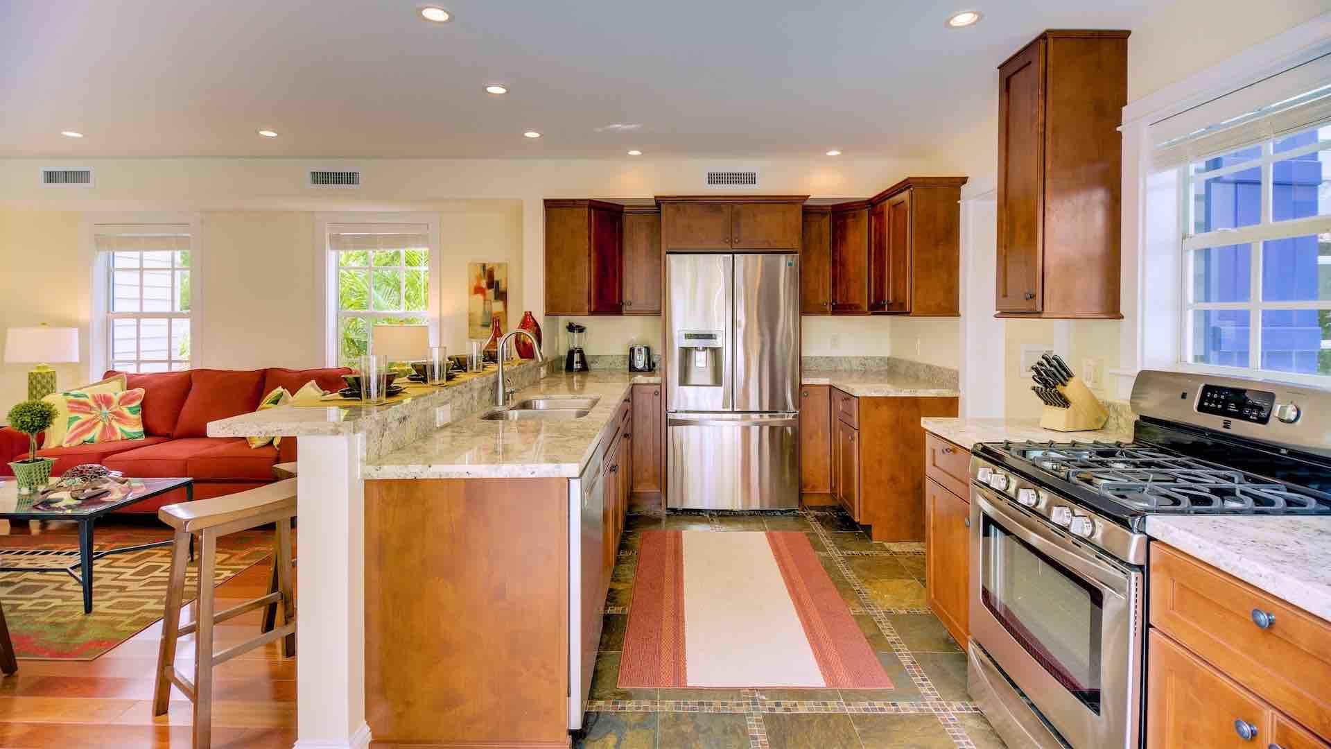 The kitchen has top of the line stainless steel appliances...