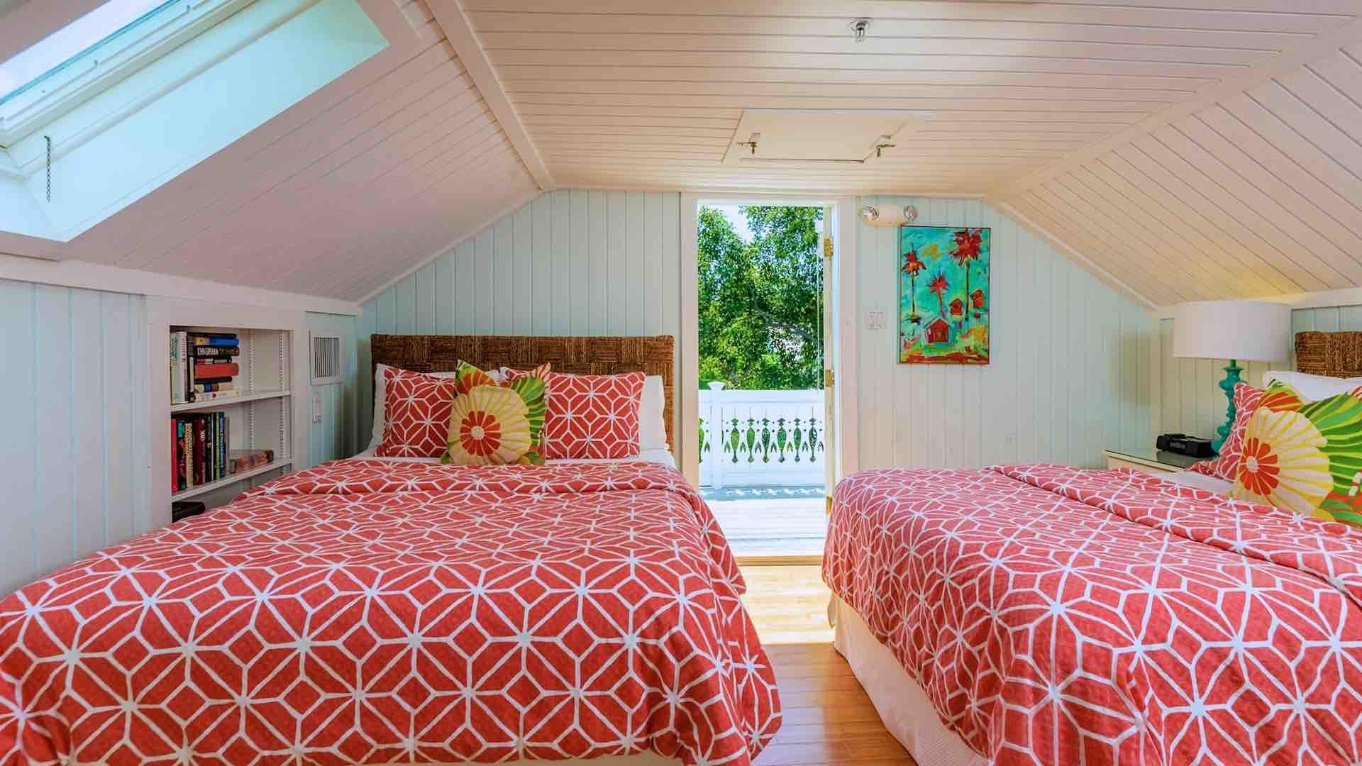 The fifth bedroom has two queen beds and access to a private sun deck.