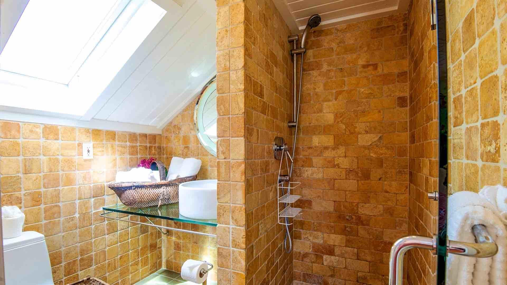 The two bedrooms on the third floor share a modern bathroom with a shower.