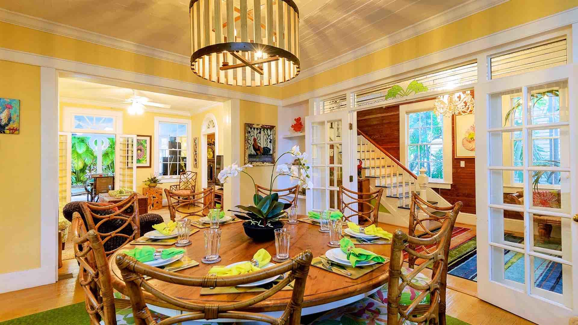 The formal dining room has a large circular dining table that seats up to ten.