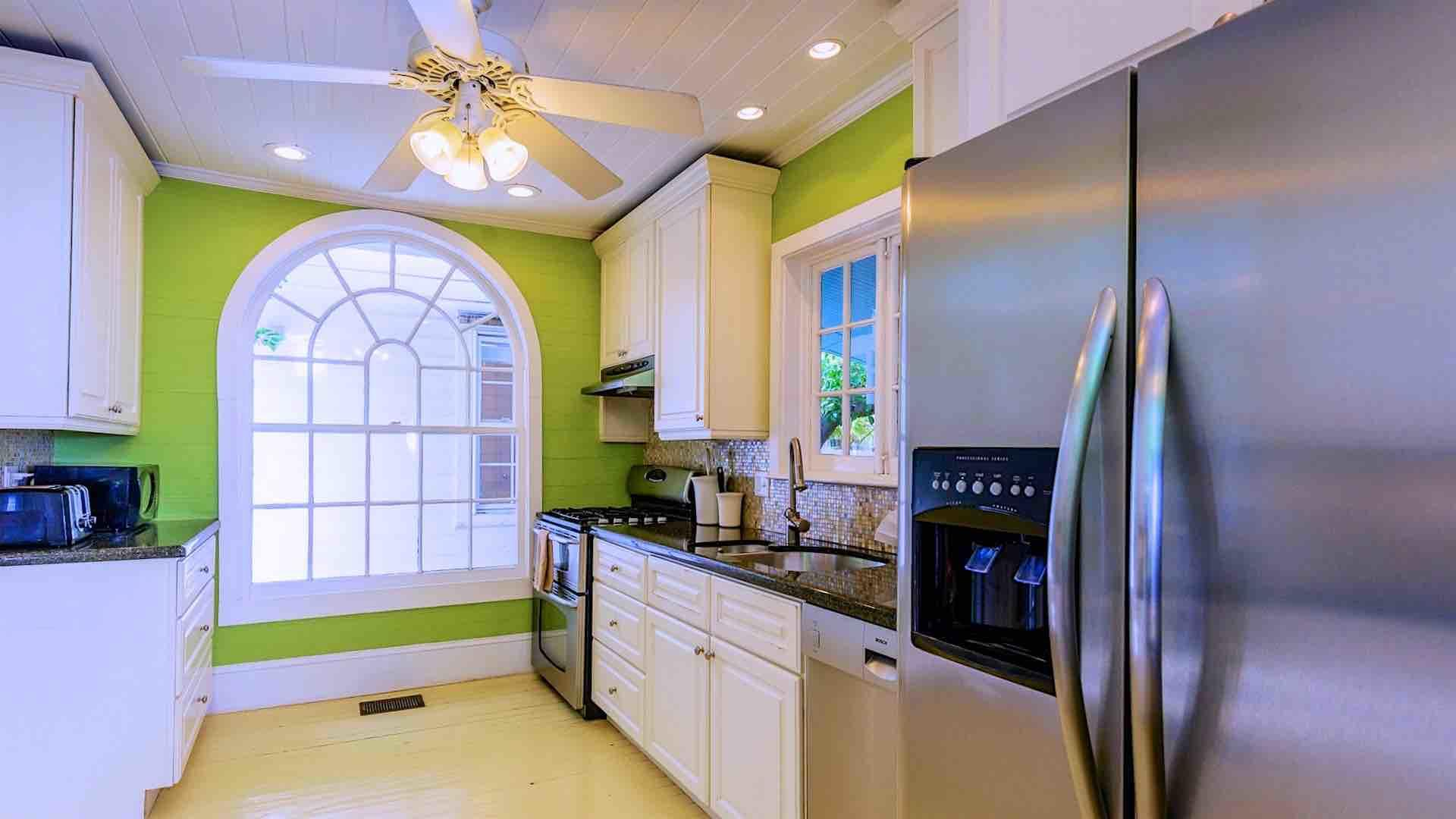 Kitchen has stainless steel appliances, and is equipped to prepare any meal.