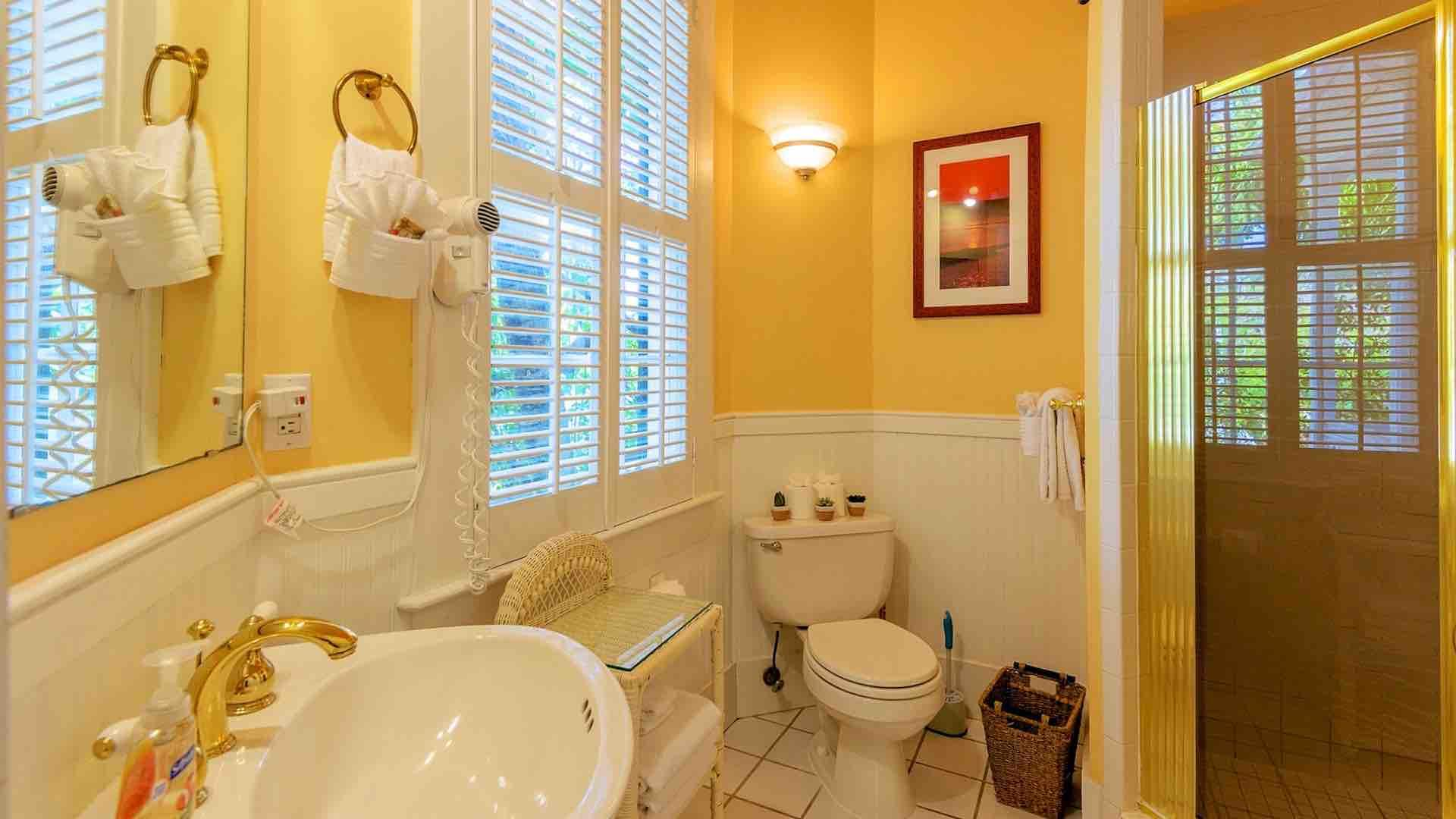 The first master bedroom has its own en suite bathroom with a shower.