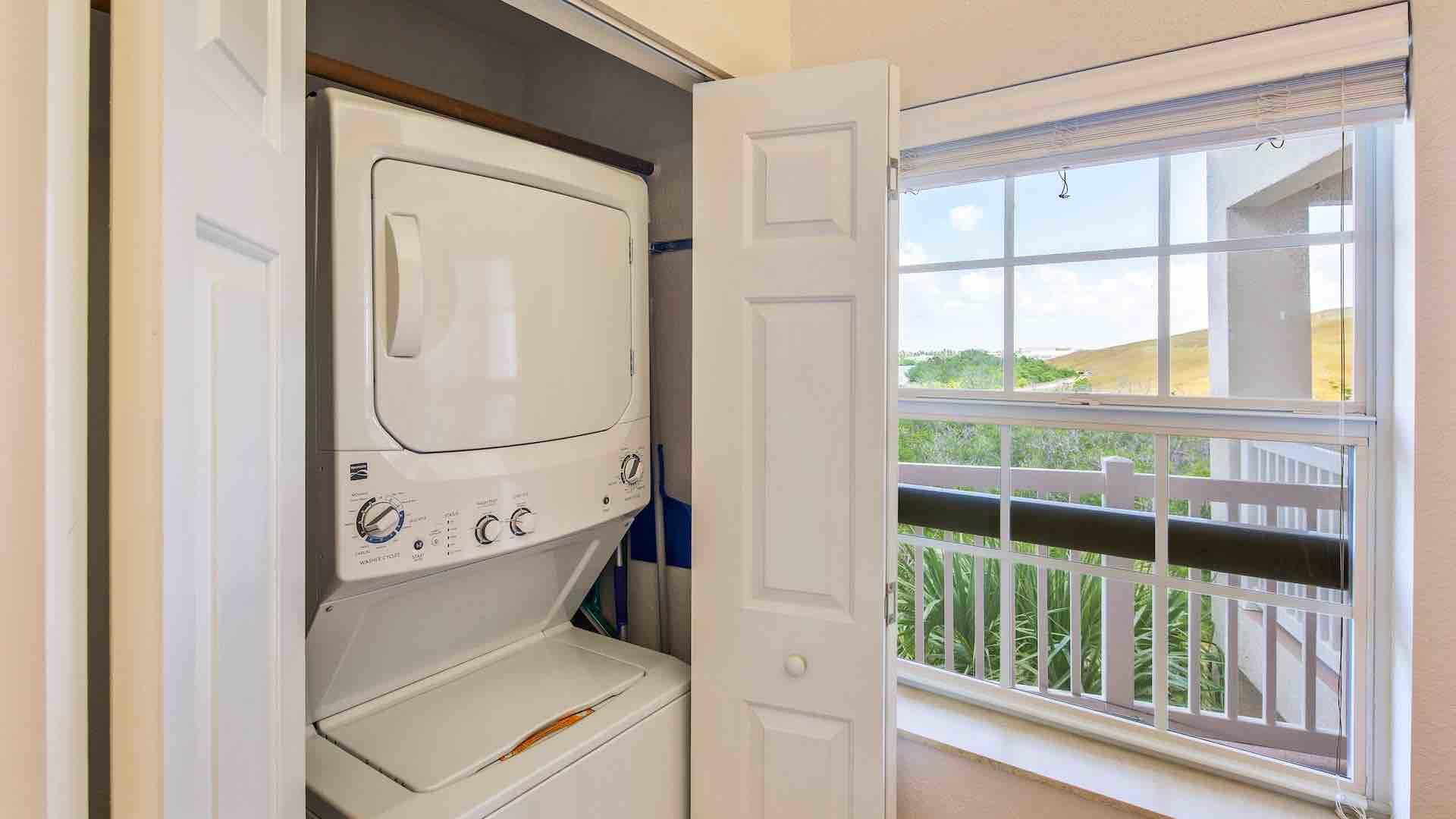 The condo has a convenient stacked washer and dryer...