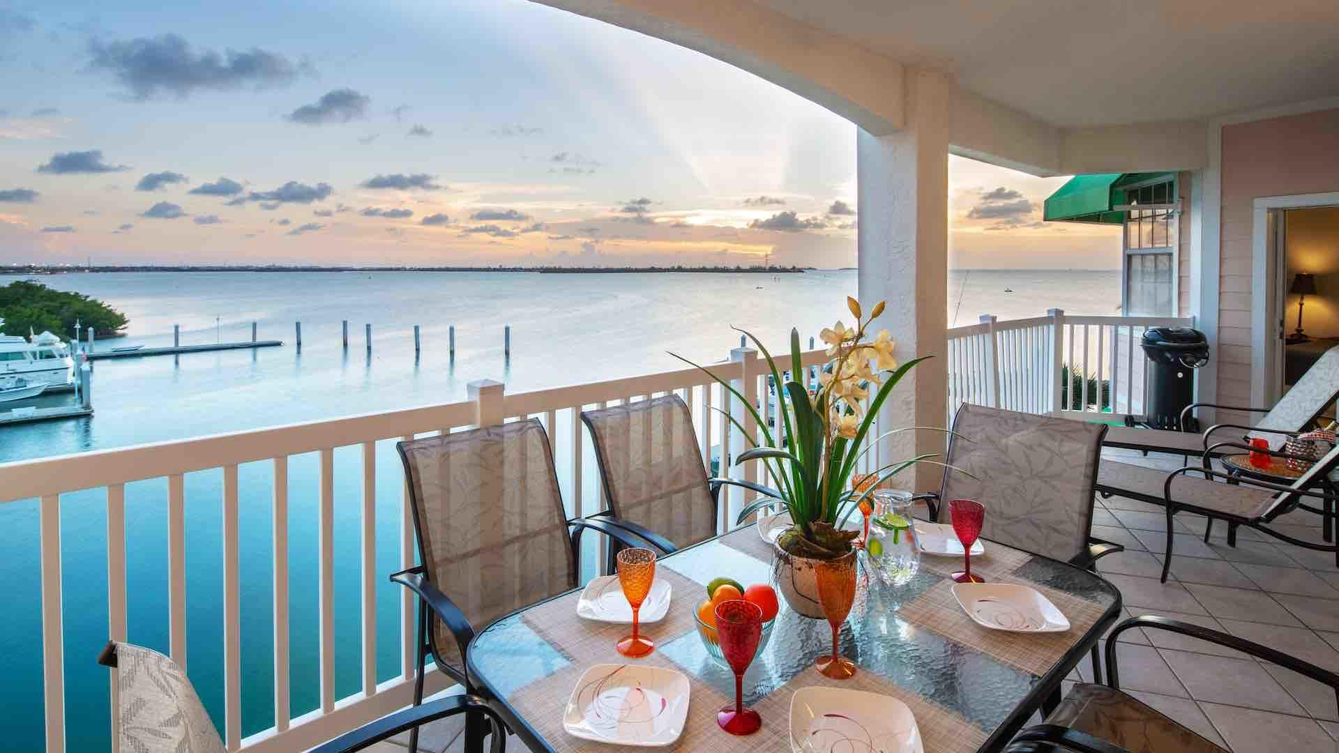 Enjoy an outdoor meal on the balcony using the dining set, with seating for six...