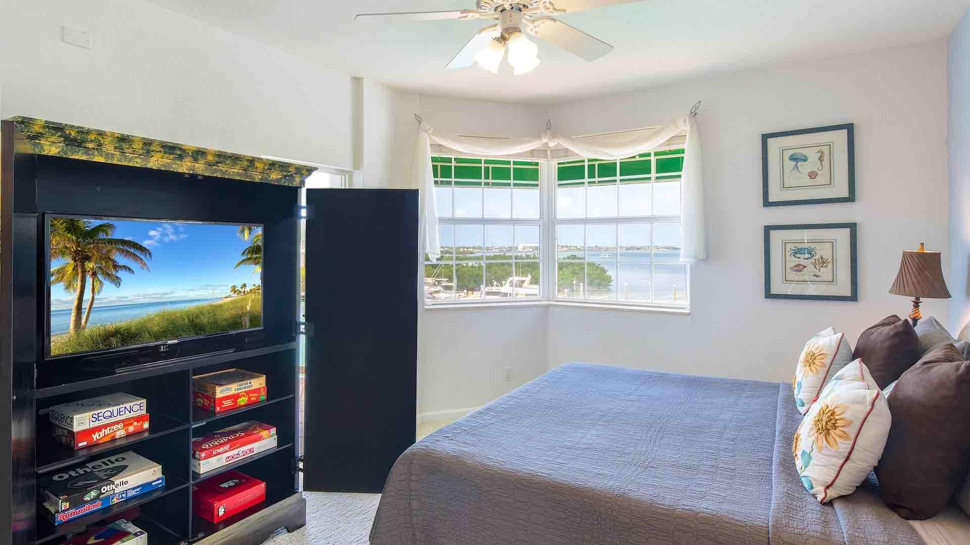 Watch your favorite shows from the comforts of the master bedroom...