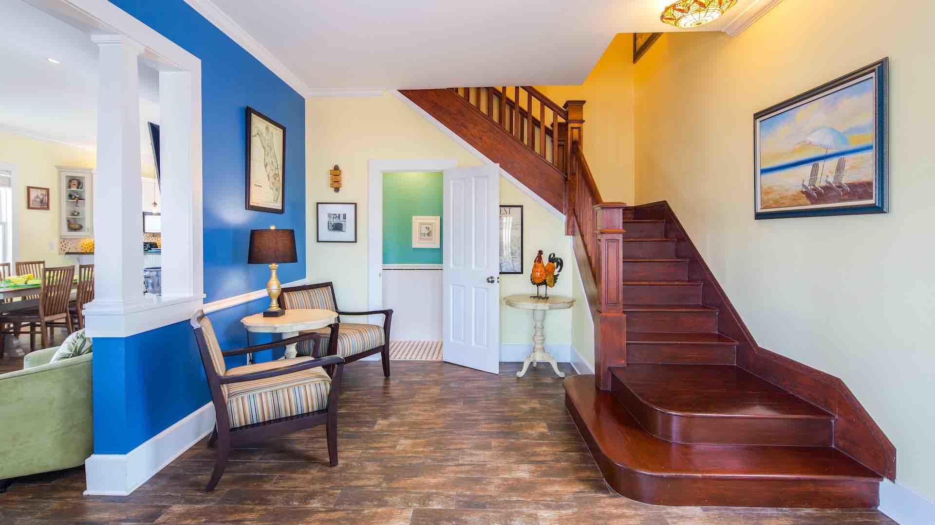 The front foyer opens up to the living room and has stairs up to the second floor...