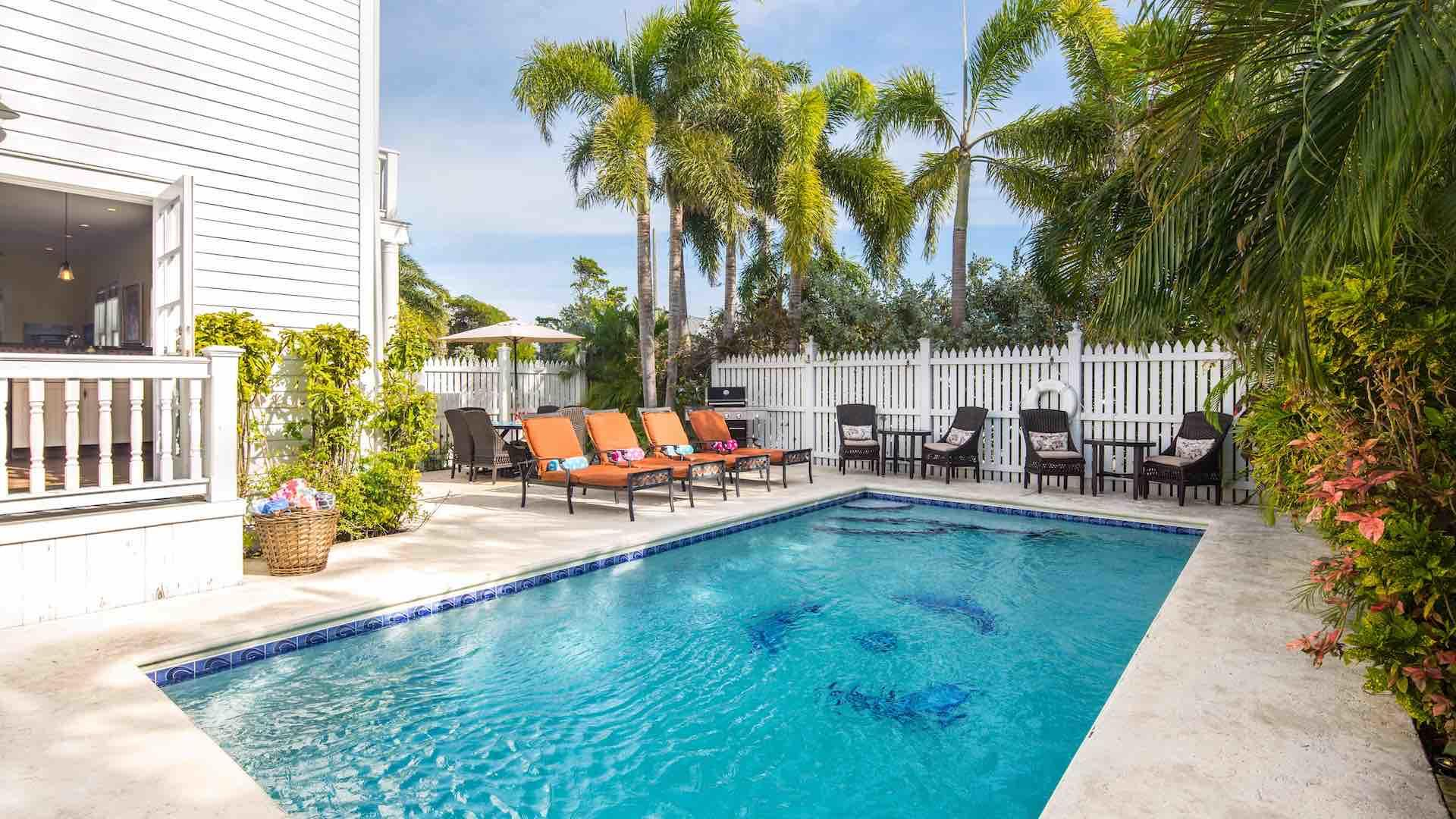 You'll have plenty of outdoor seating options around the pool...