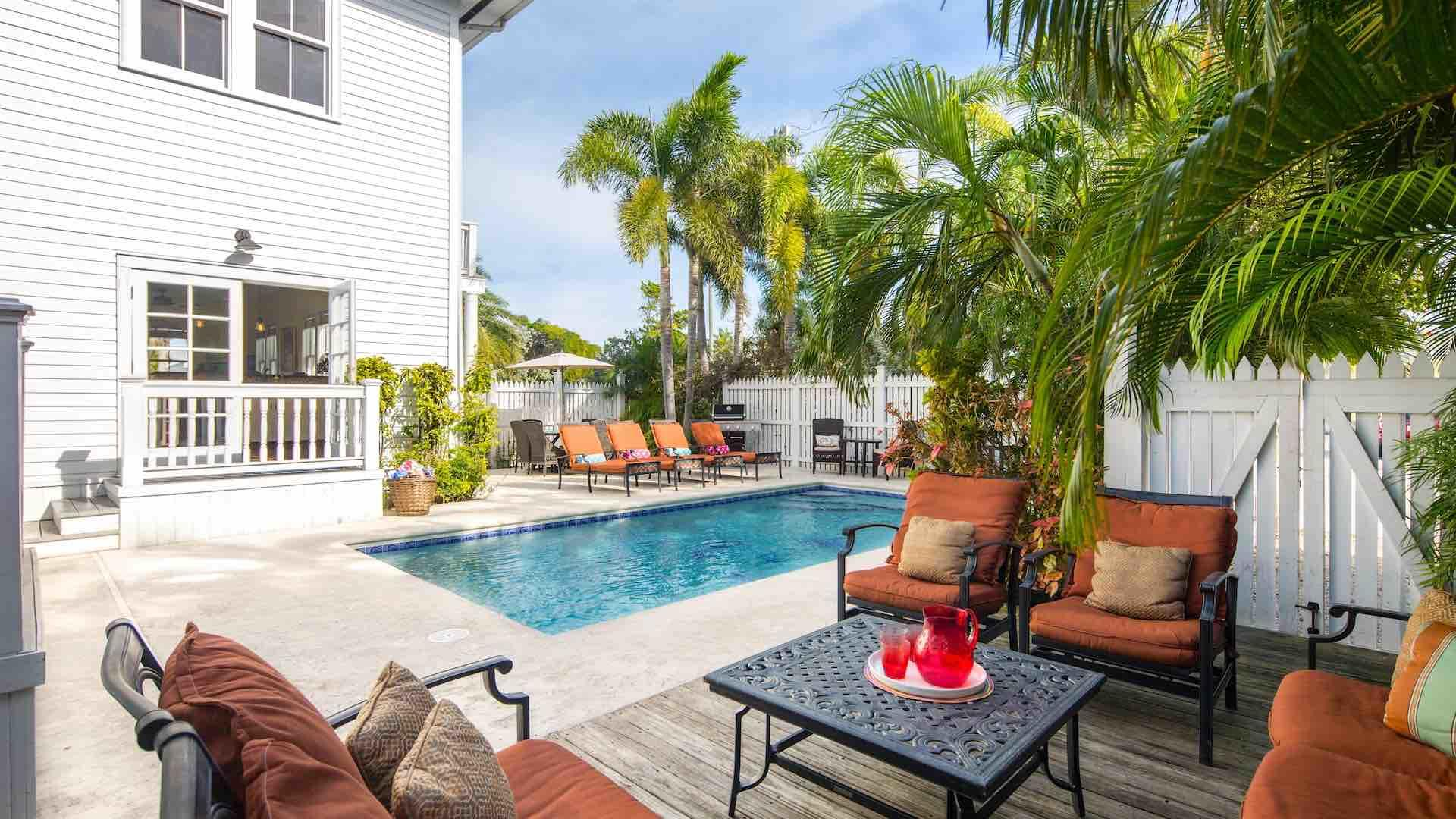 Southernmost Hospitality V has a spacious back yard with a tall fence surrounding the large private pool...