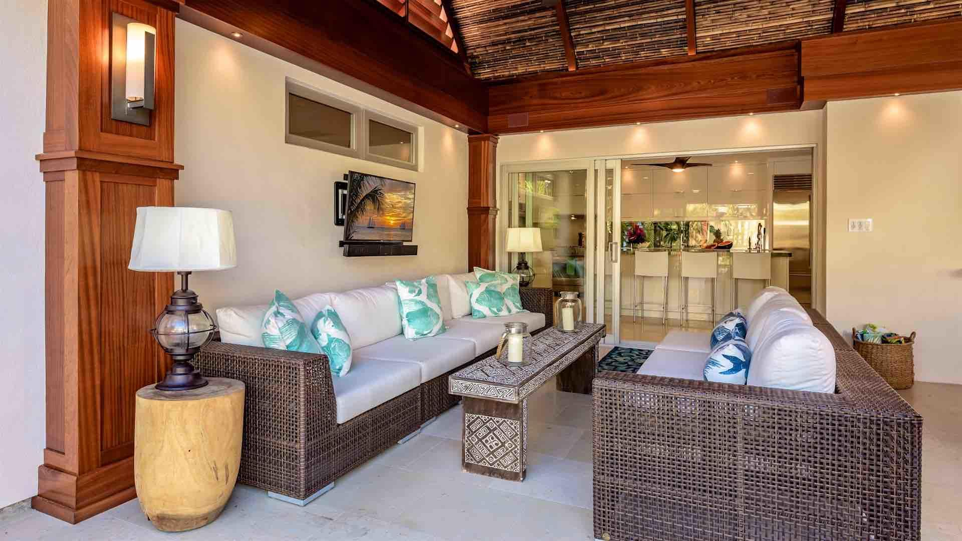 The covered lanai features a large flat screen TV and comfortable outdoor sofas...