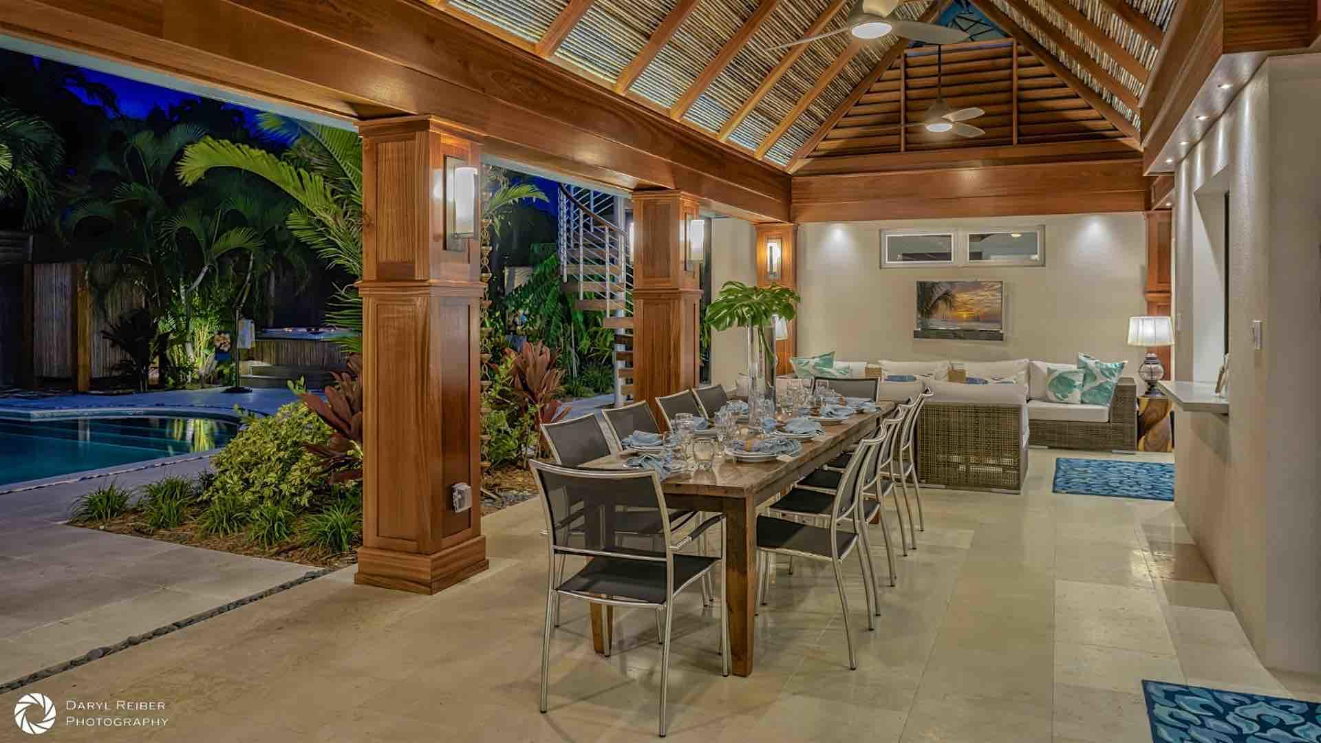 The covered lanai offers overhead fans and plenty of lighting so you can enjoy using it day or night...