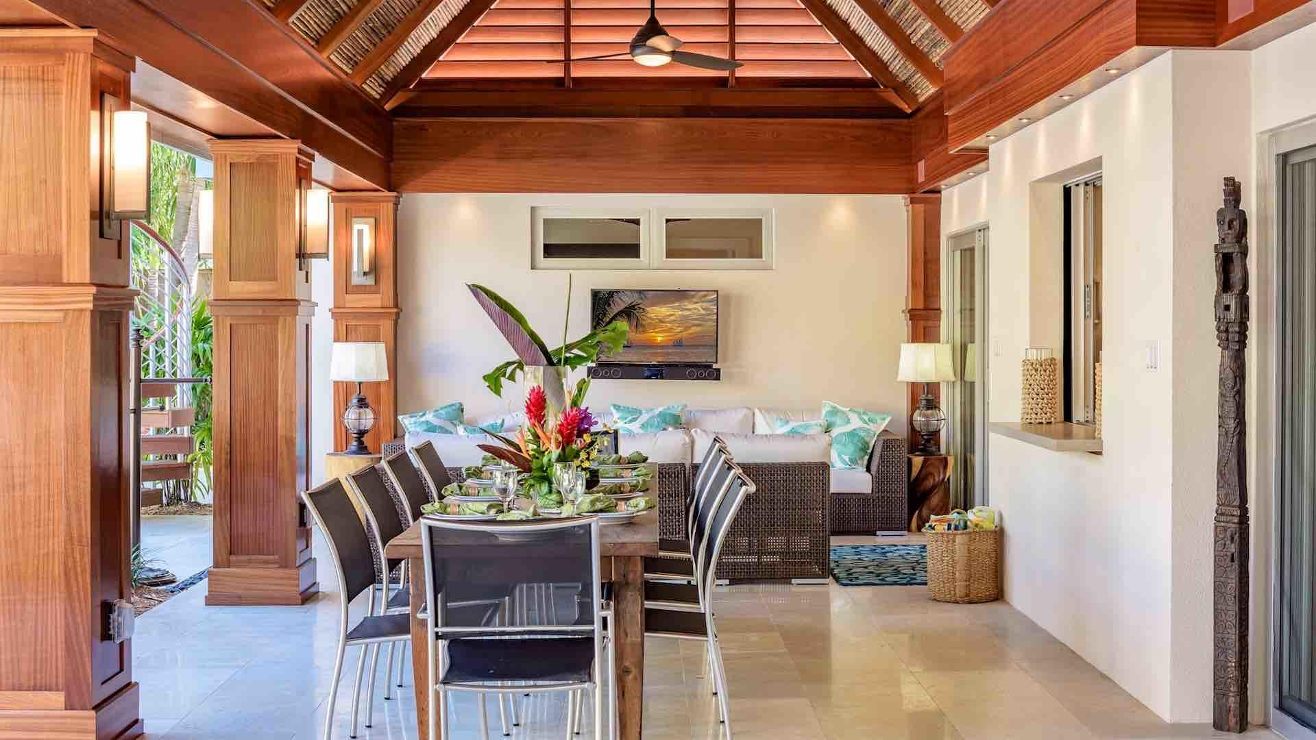 A covered lanai spans the entire length of the house with multiple lounging and dining areas...