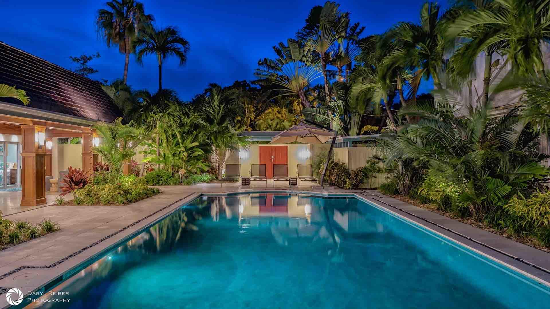 The entire property is surrounded by a privacy wall, and boasts a lushly landscaped front and back yard...
