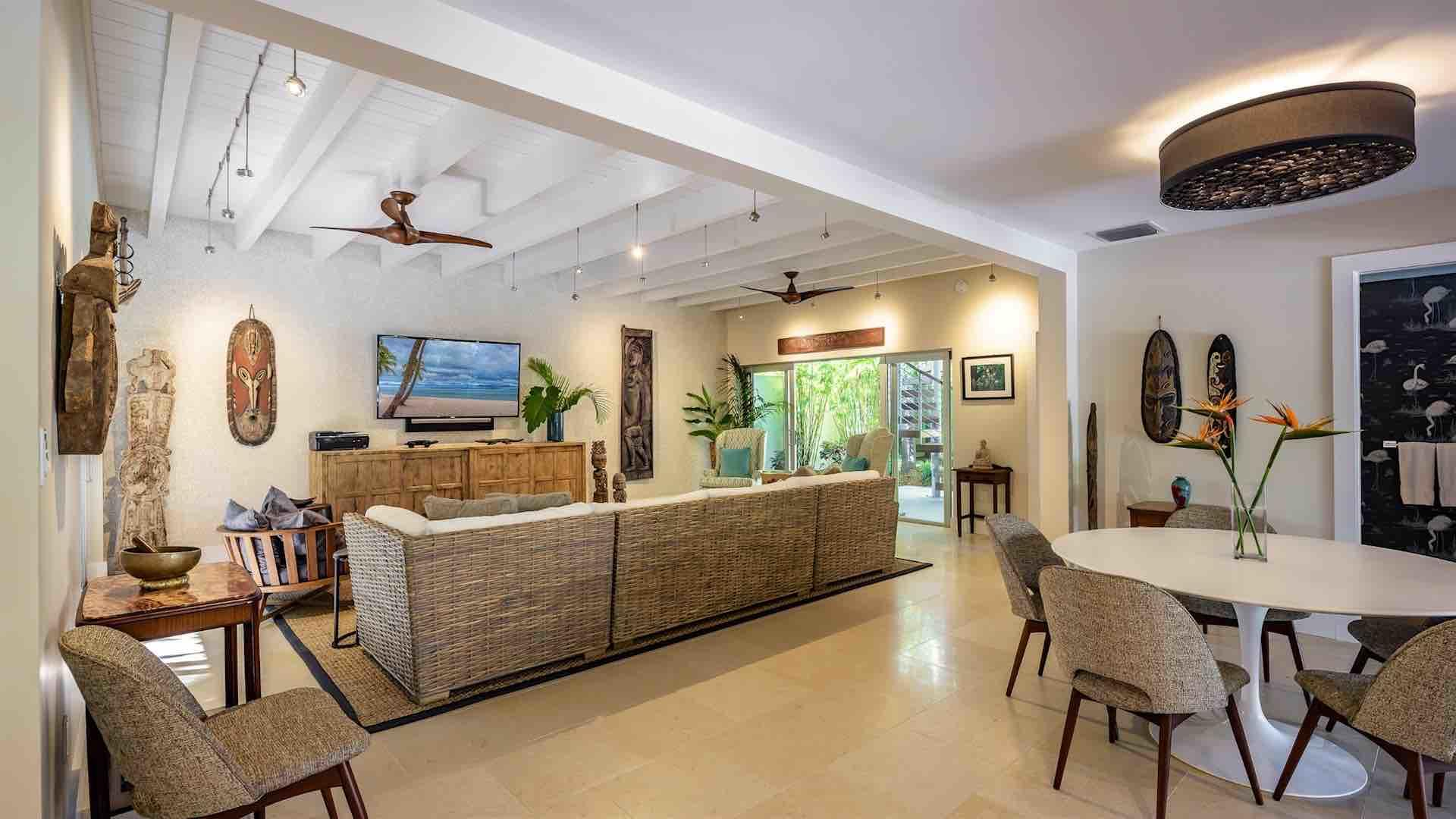 Let the island breeze flow through the home, by throwing open the large sliding glass doors...