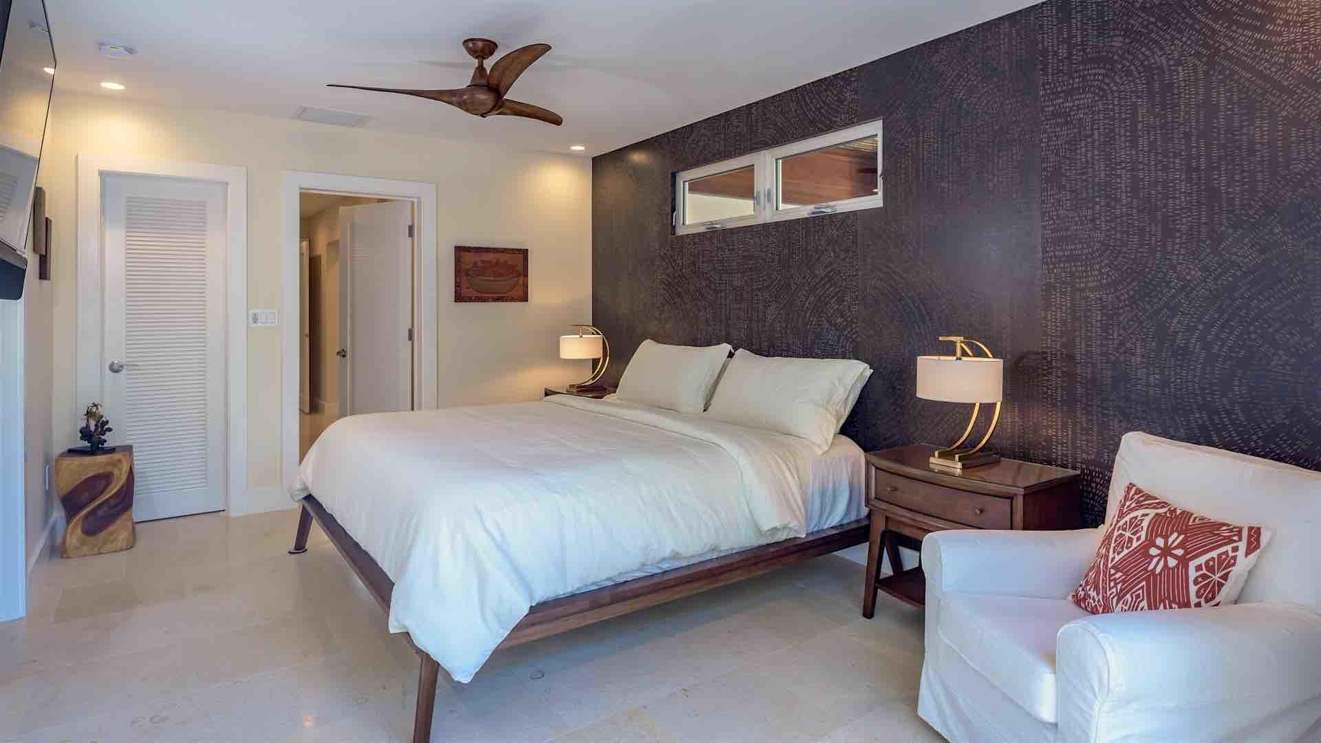 The master bedroom has a King bed, an overhead fan, and plenty of closet space...