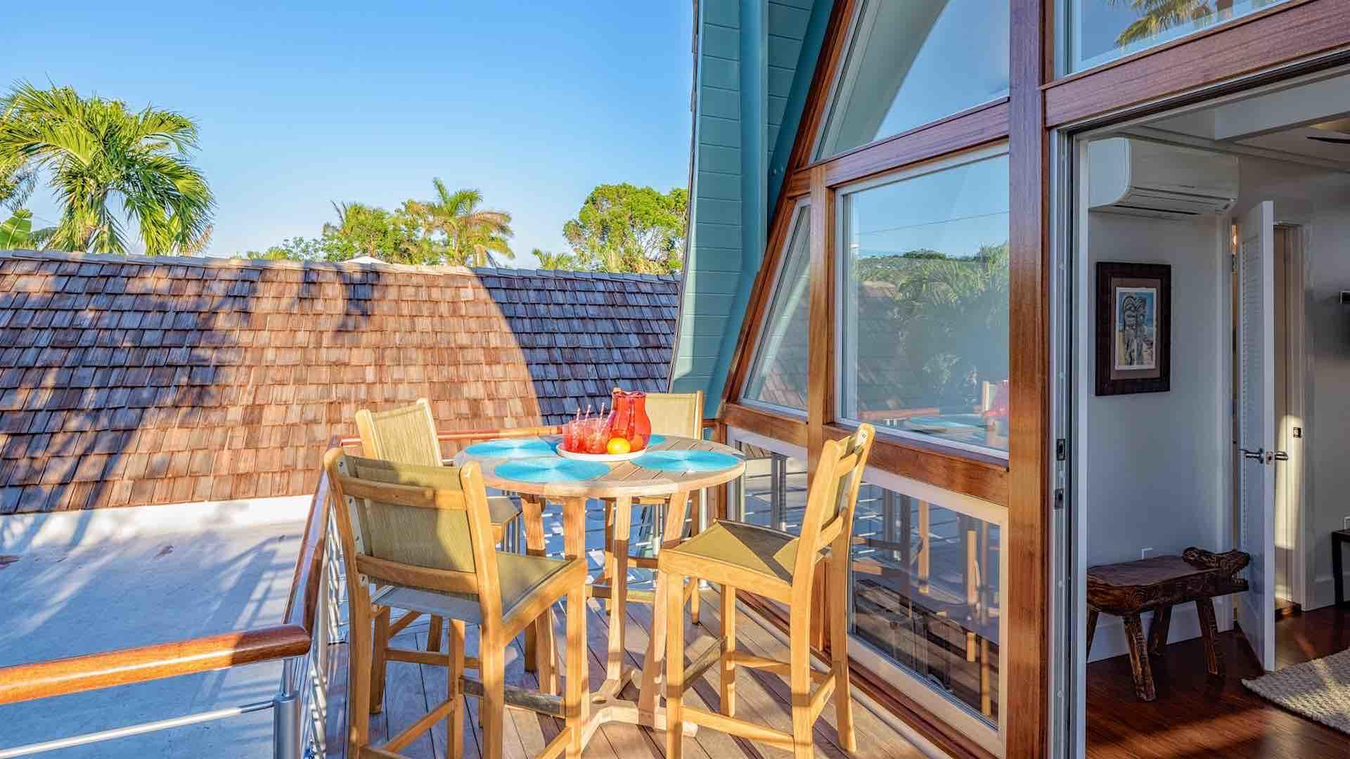 An outdoor dining table for four is located on the roof just outside the fourth bedroom...